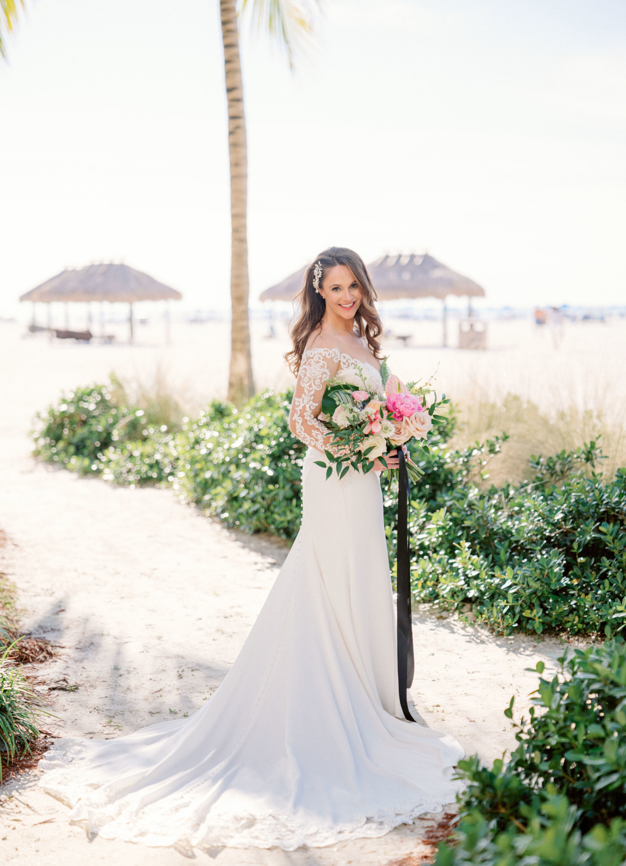 bride wearing lace and crepe gown