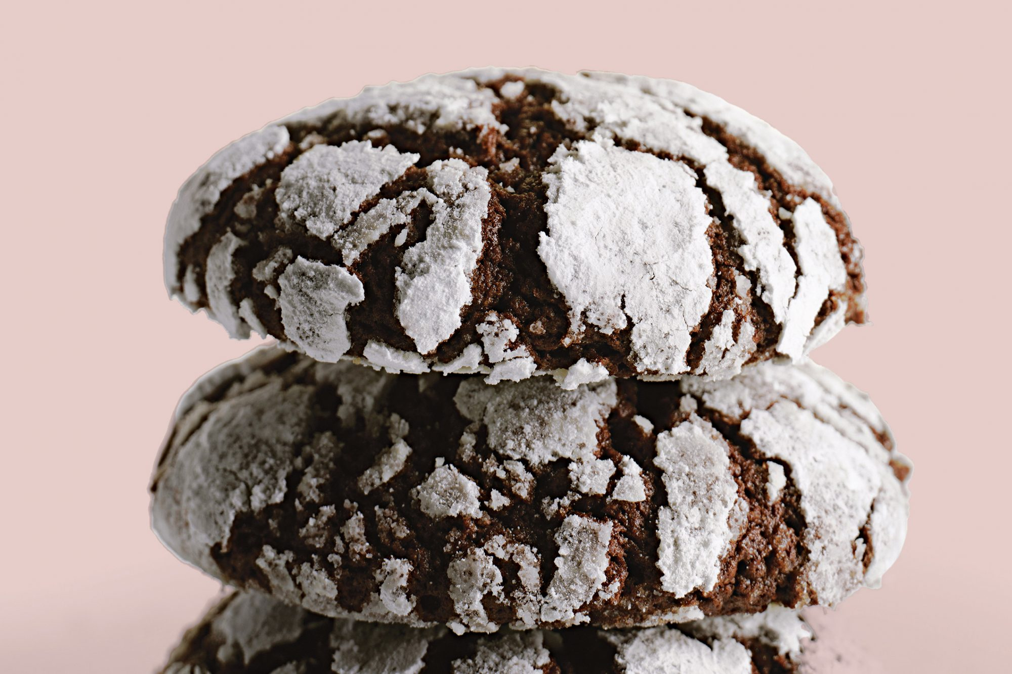 To create the appearance of a snow-kissed fudgy cookie, this chocolate cookie dough is rolled in confectioners' sugar just before baking.