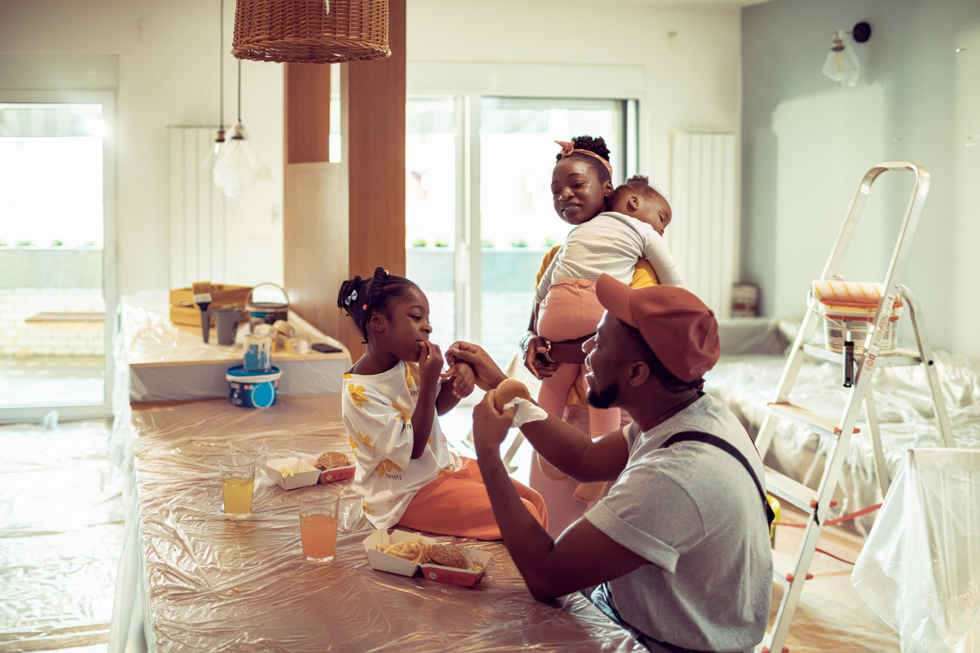 young family taking break while renovation home interior
