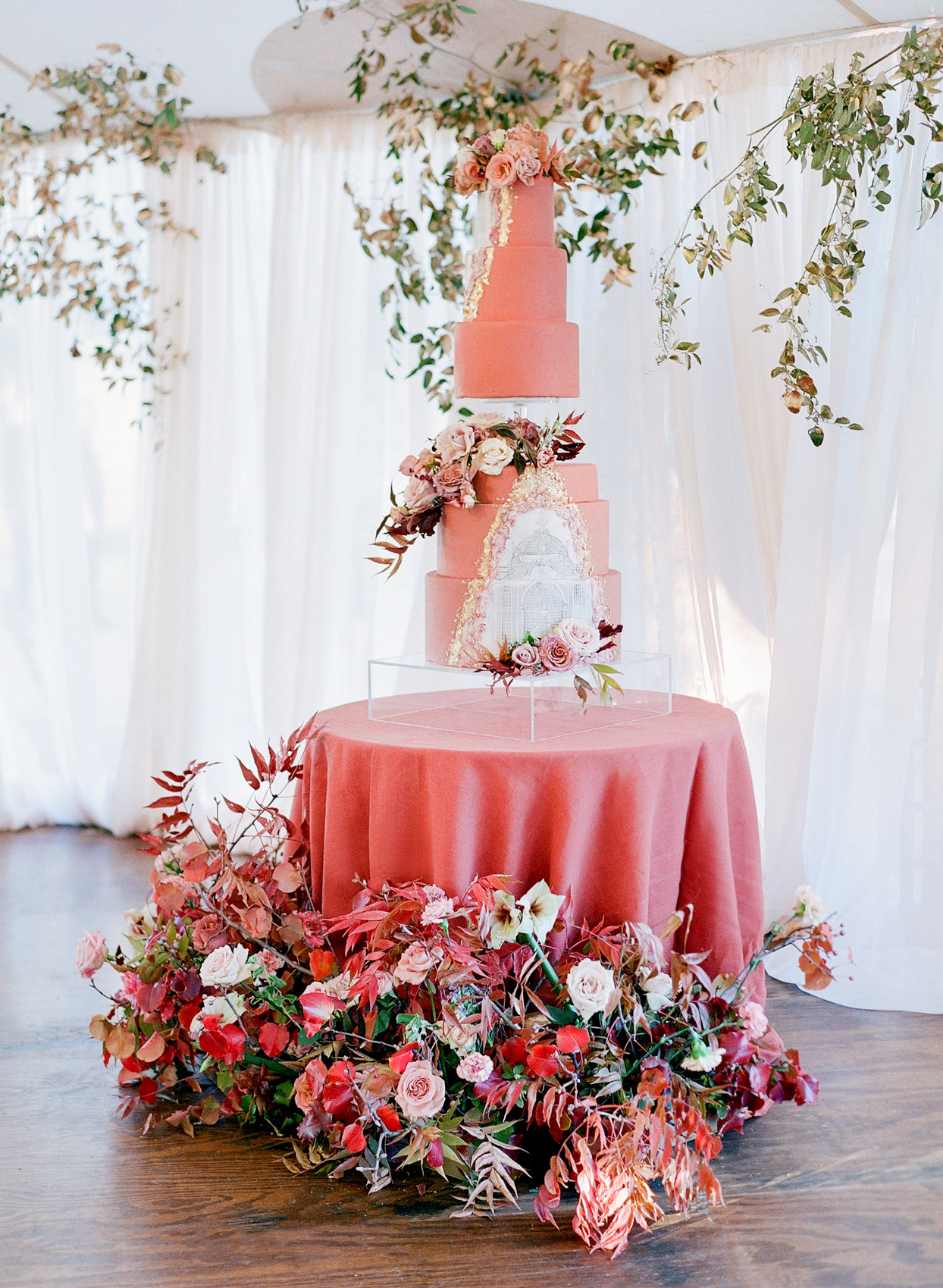 fancy coral wedding cake with architecture design and flowers