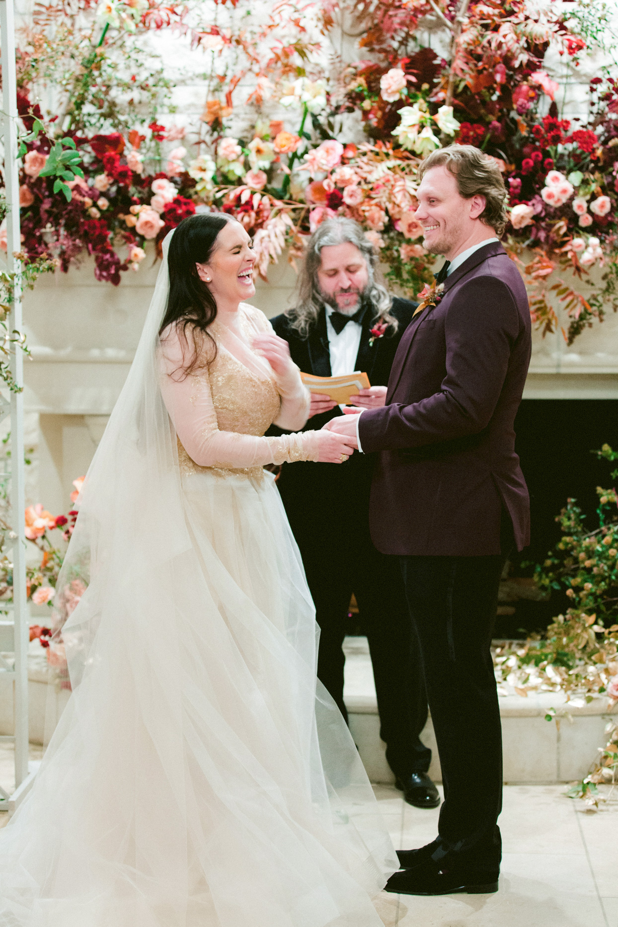 couple smiling and laughing during wedding ceremony vows