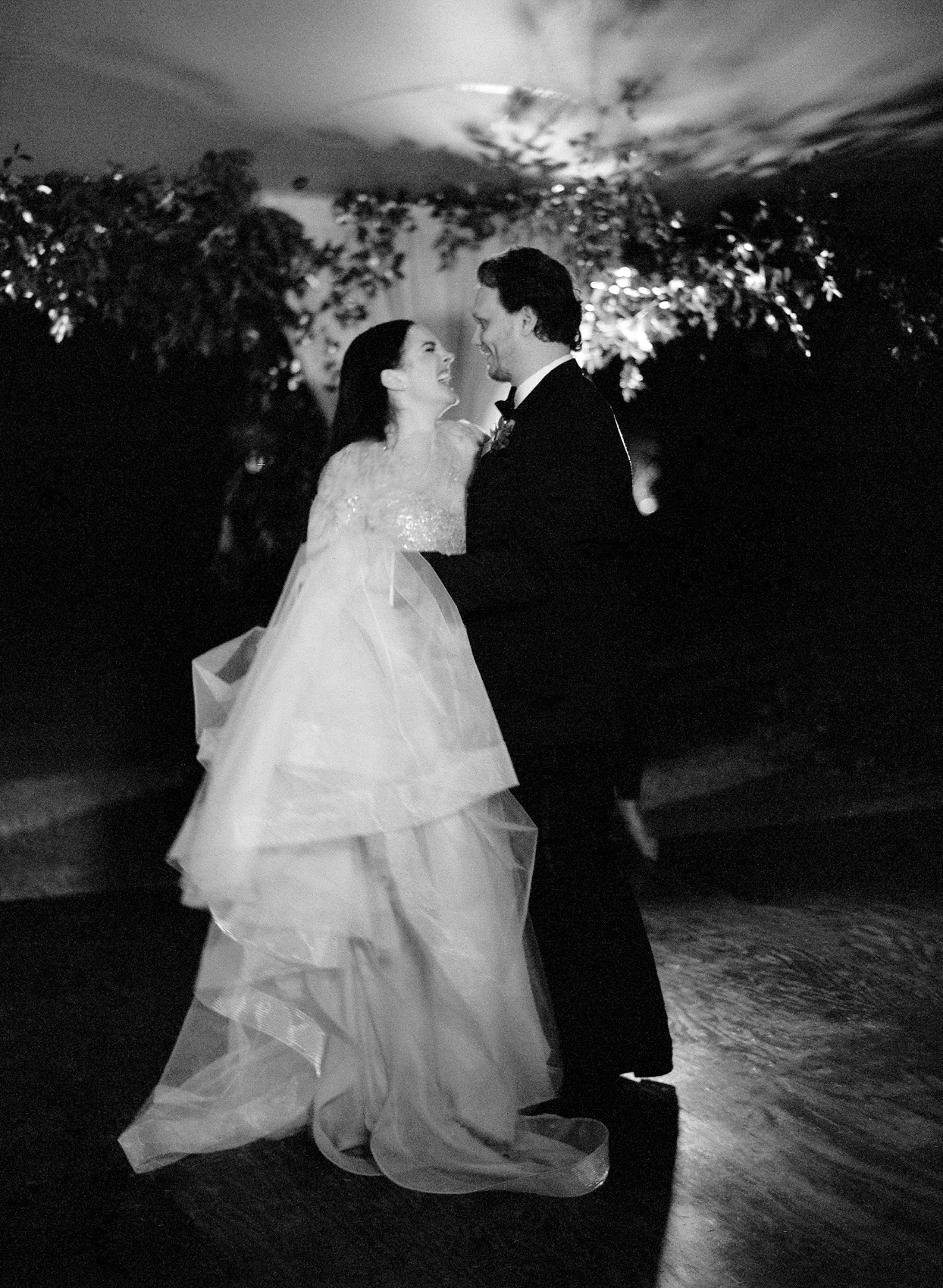 couple laughing together during first dance