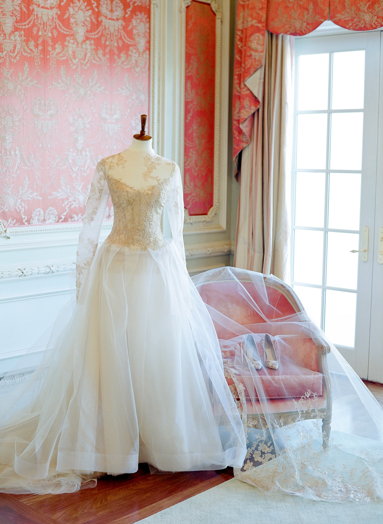 wedding dress on mannequin with gold shoes