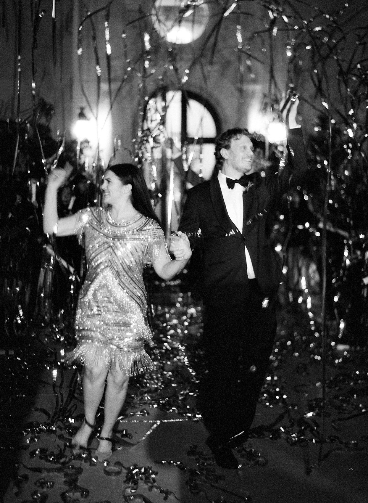 bride in flapper dress and groom exiting wedding reception