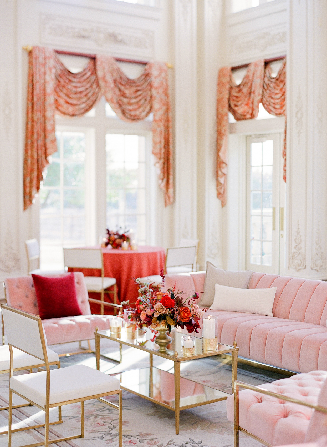 elegant indoor wedding lounge with gold and pink furniture