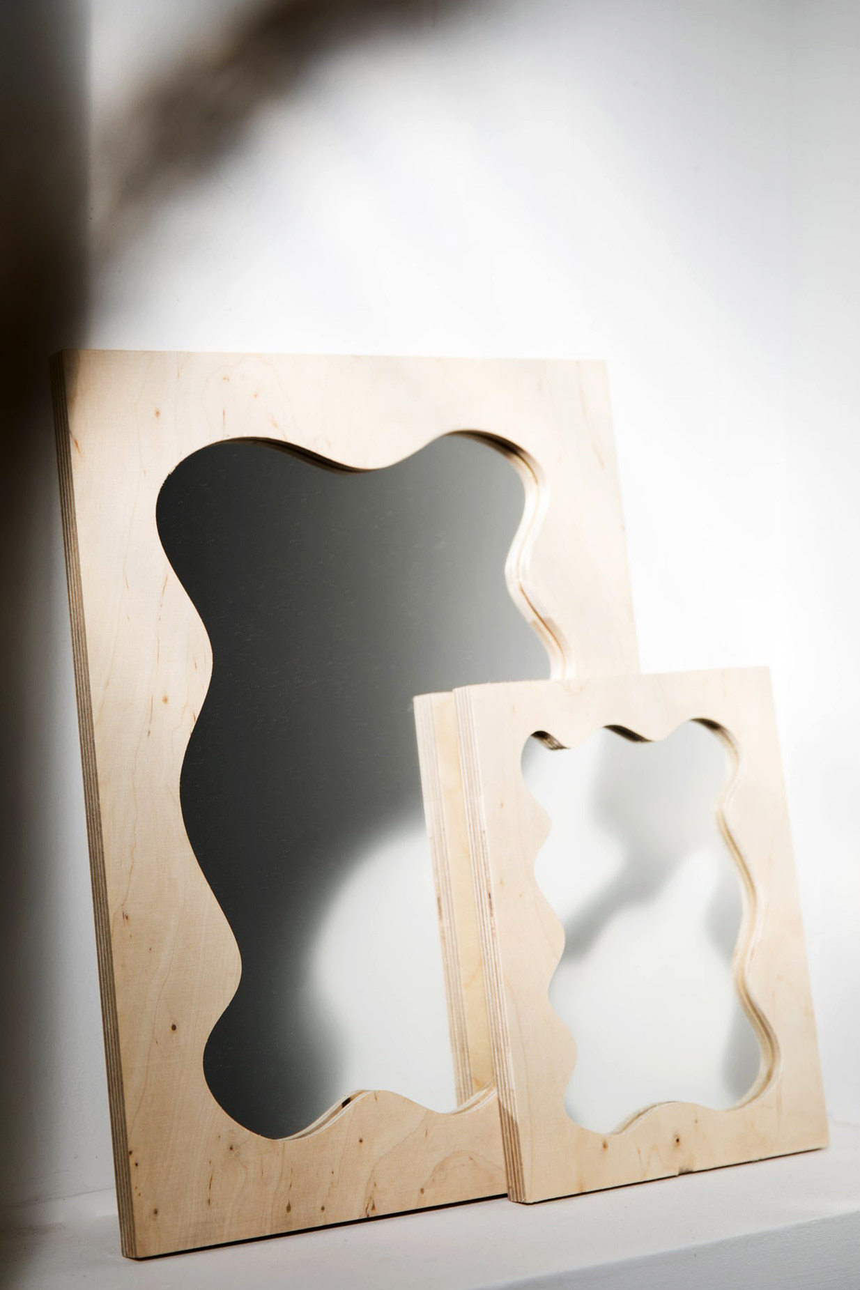 squiggly shaped wood mirror