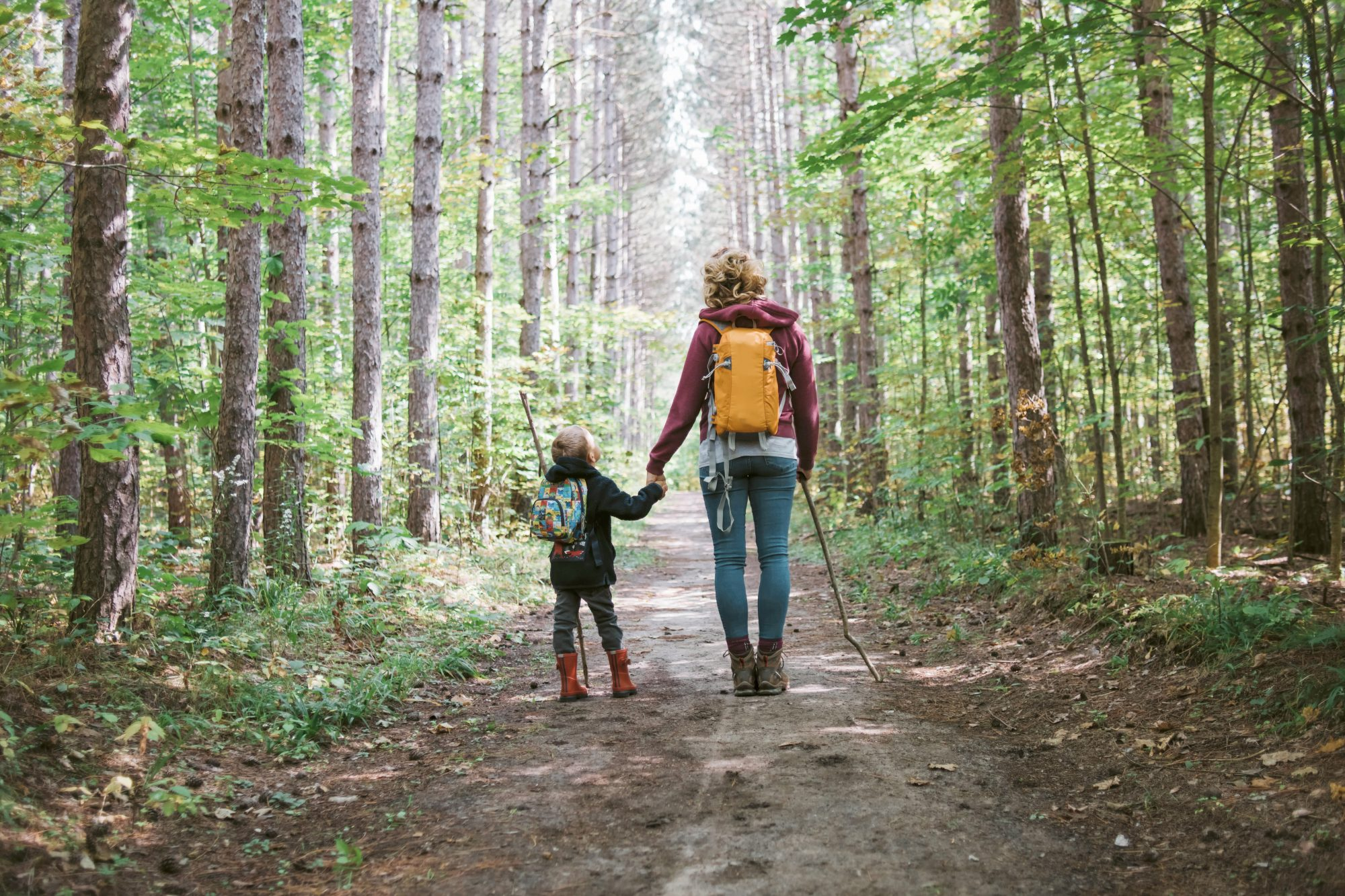 woman and child hiking in forest