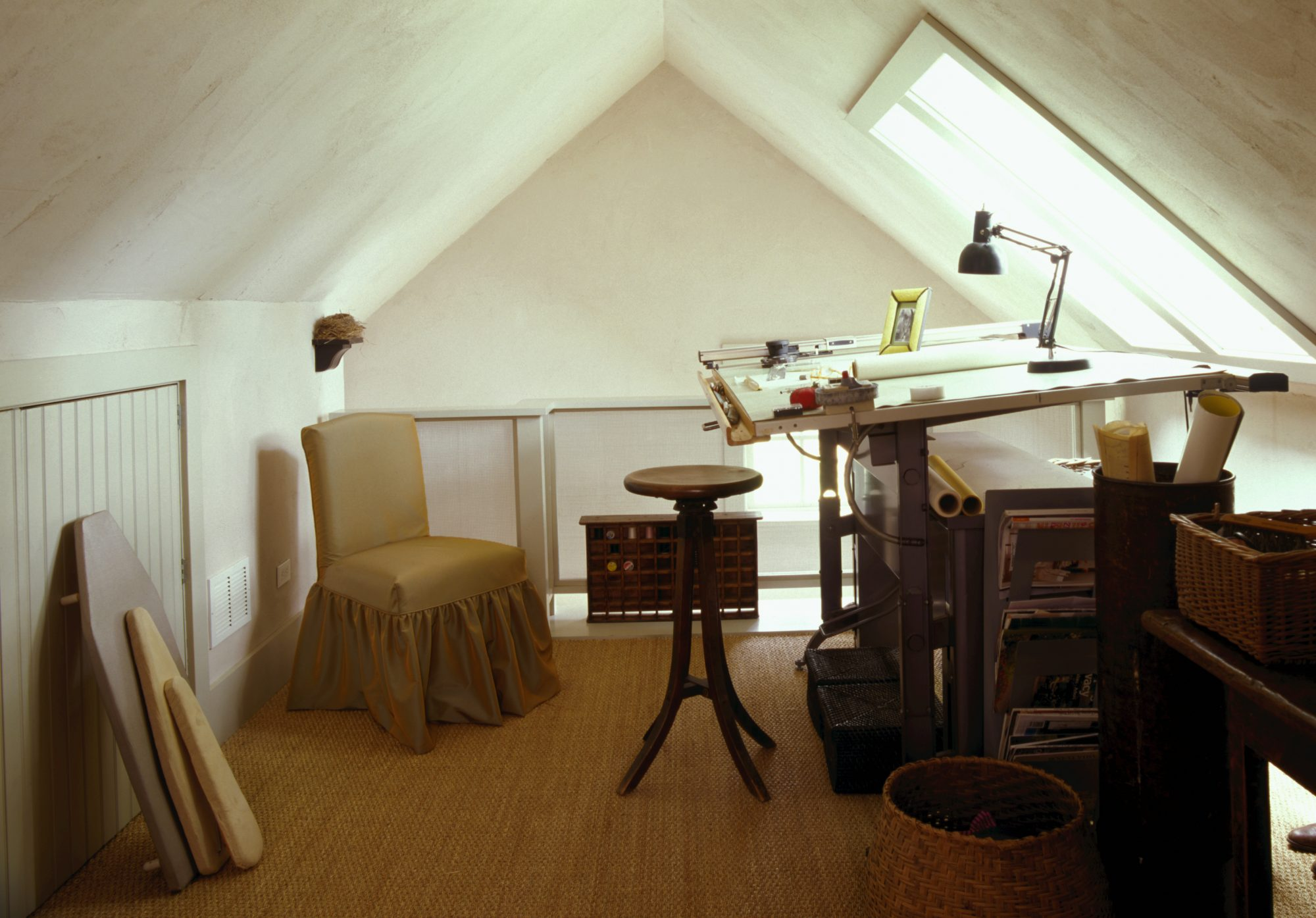 attic home office with drafting table