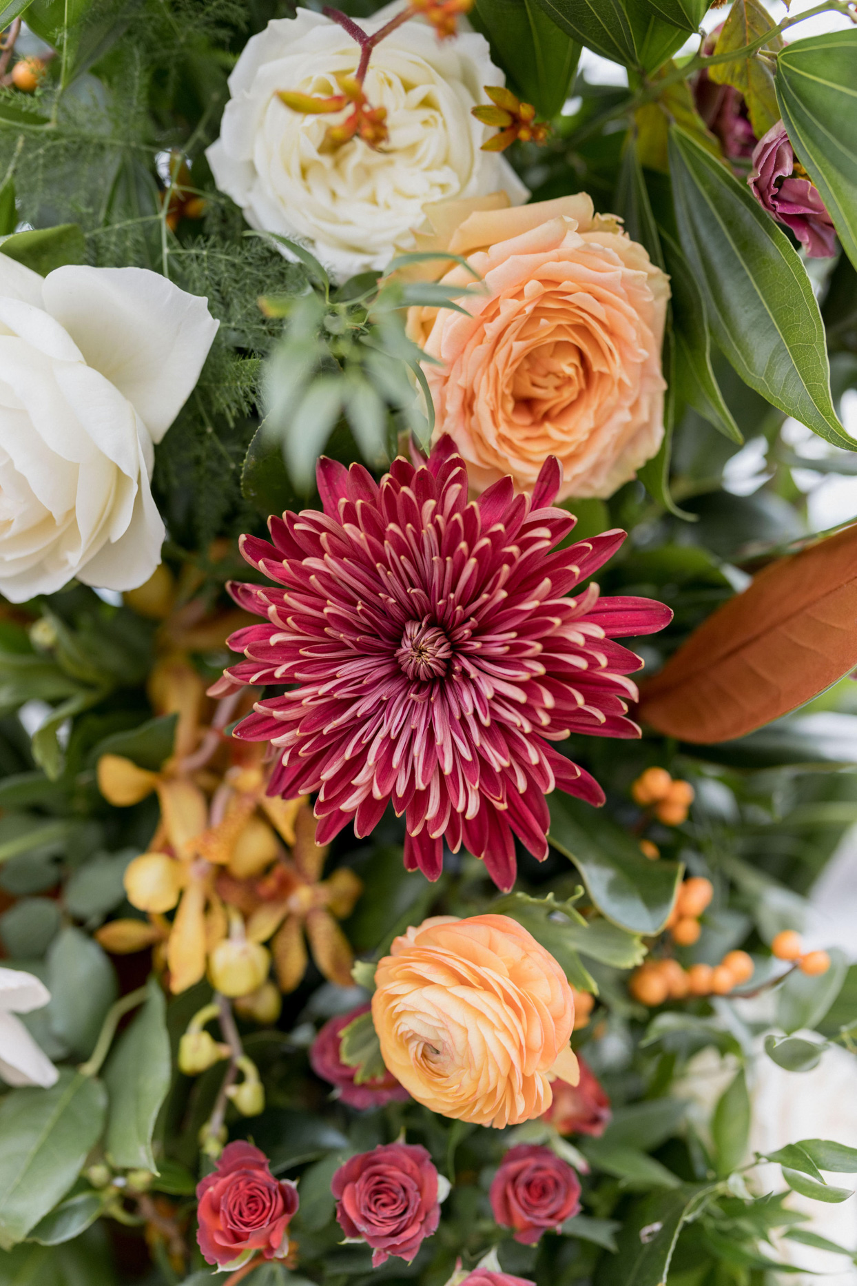 red and orange floral wedding arch