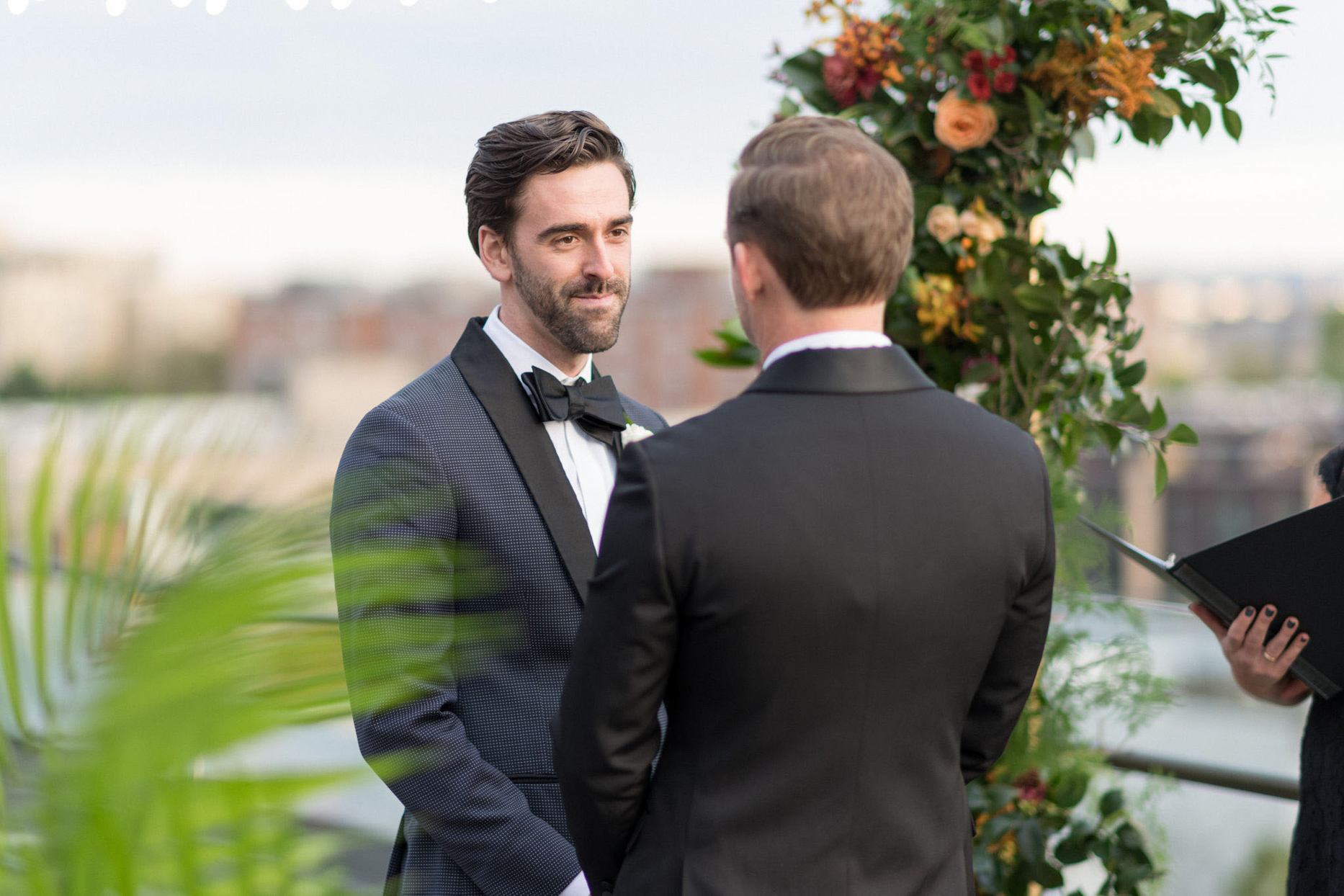 grooms looking at each other during wedding ceremony vows