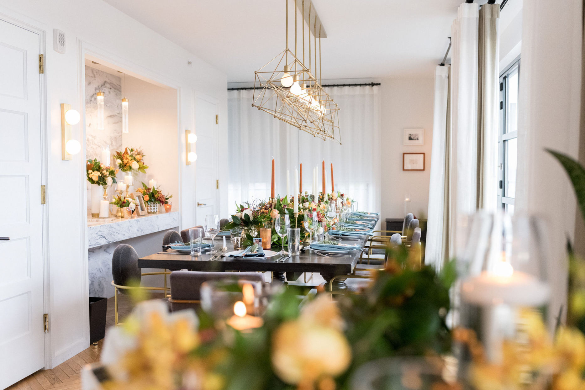 indoor wedding reception modern table scape with florals and candles