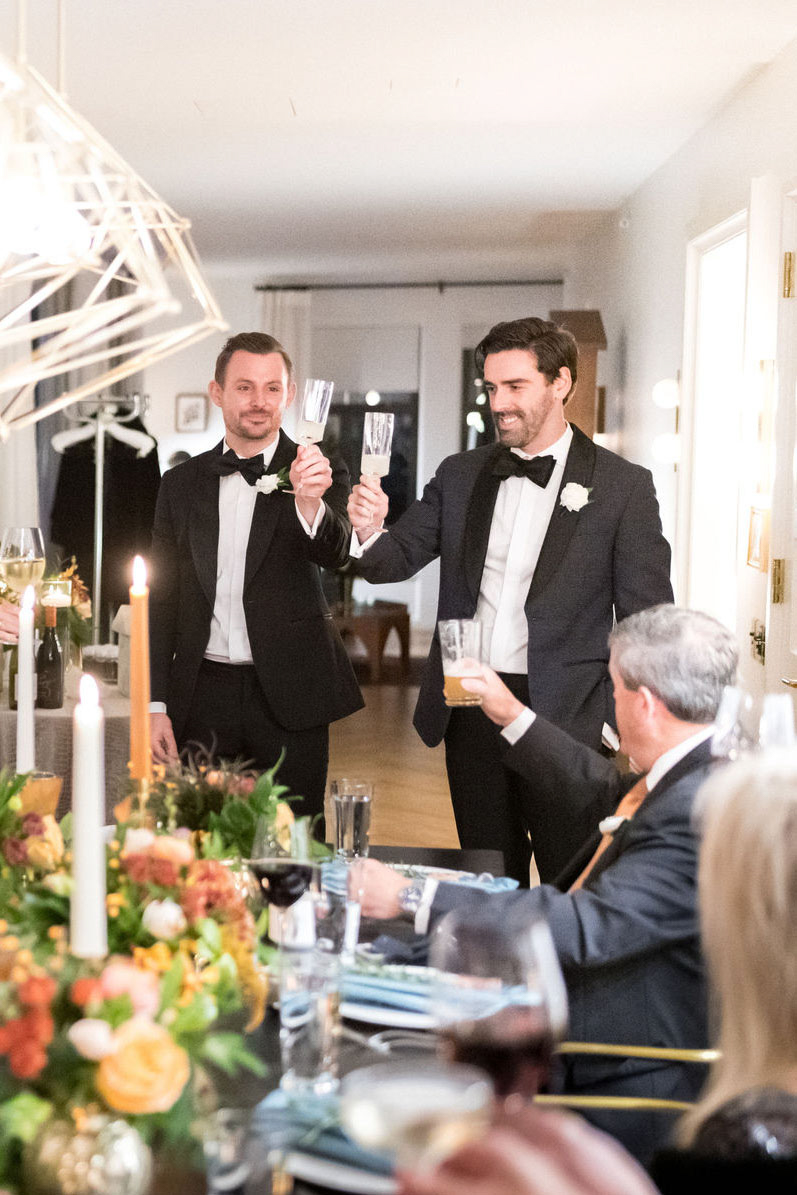 grooms toasting at small wedding reception
