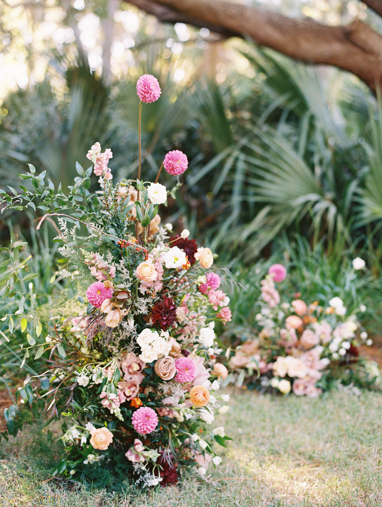 large pink, orange, and burgundy floral ceremony bouquets