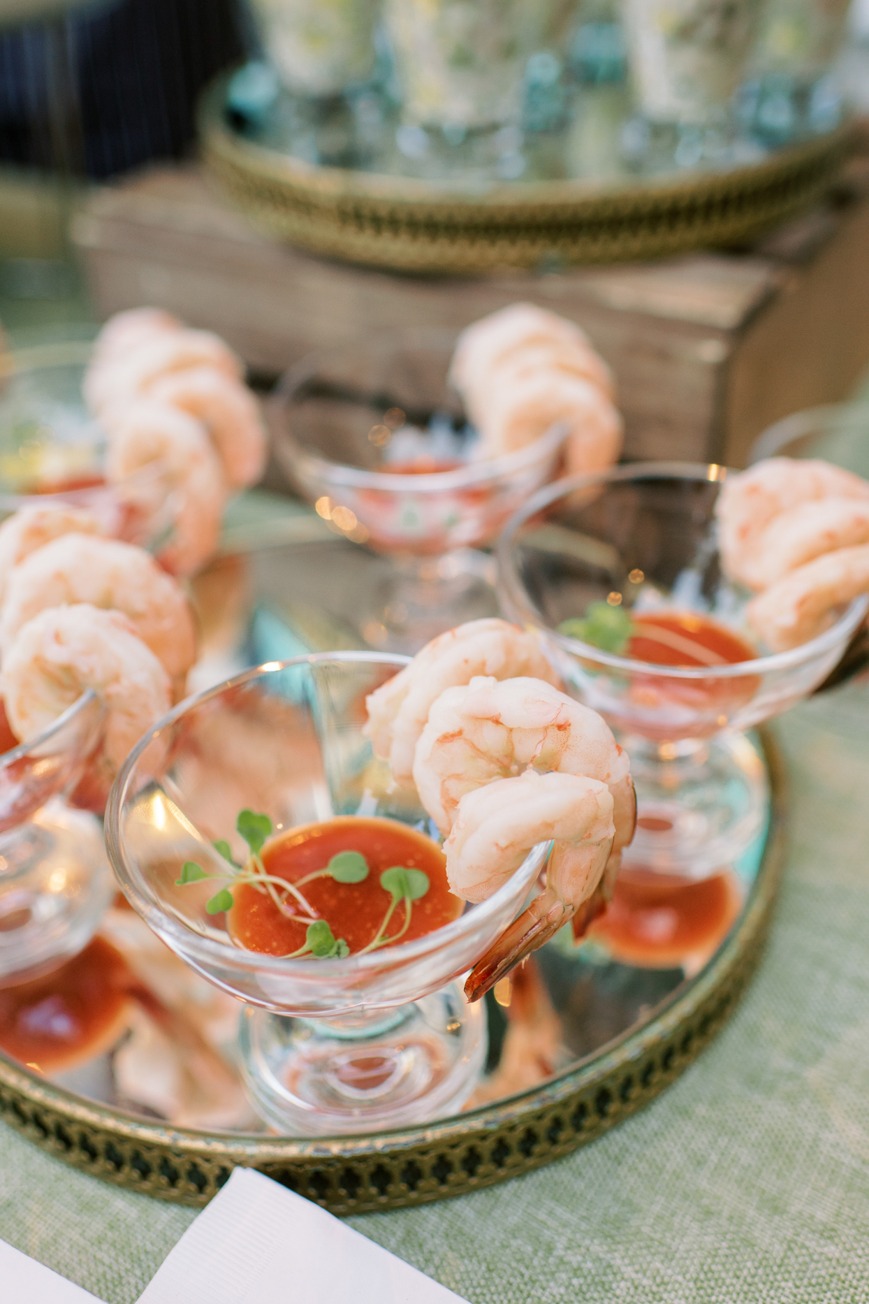 wedding happy hour shrimp cups on gold and glass plate