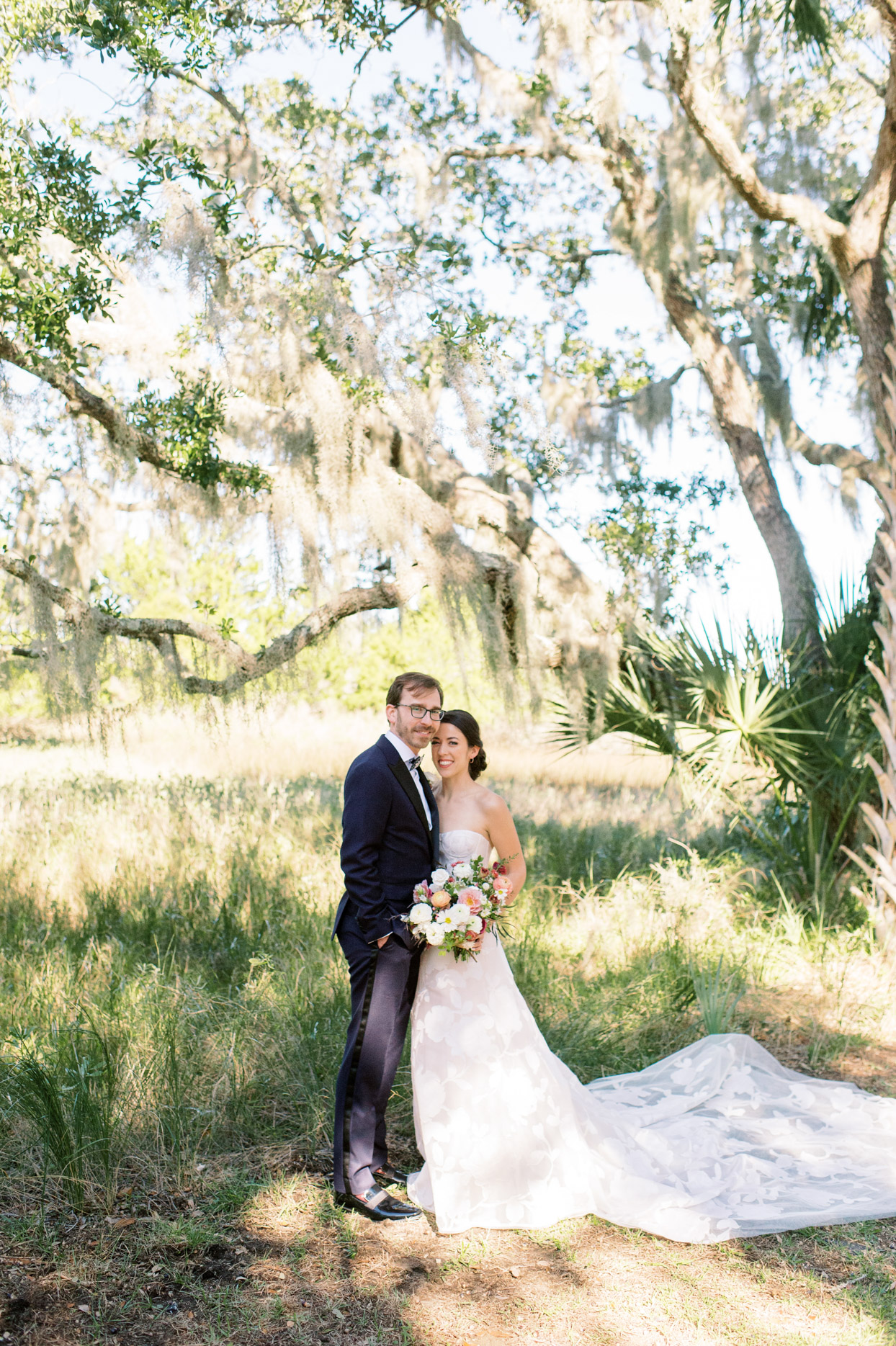 wedding couple portrait with grassy backdrop