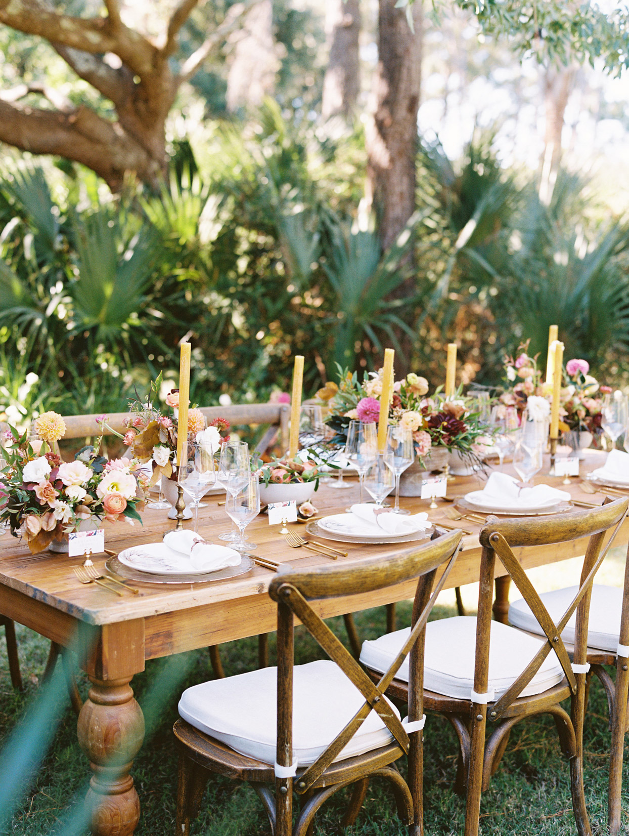 detail shot of elegant wooden reception tables with florals and candles