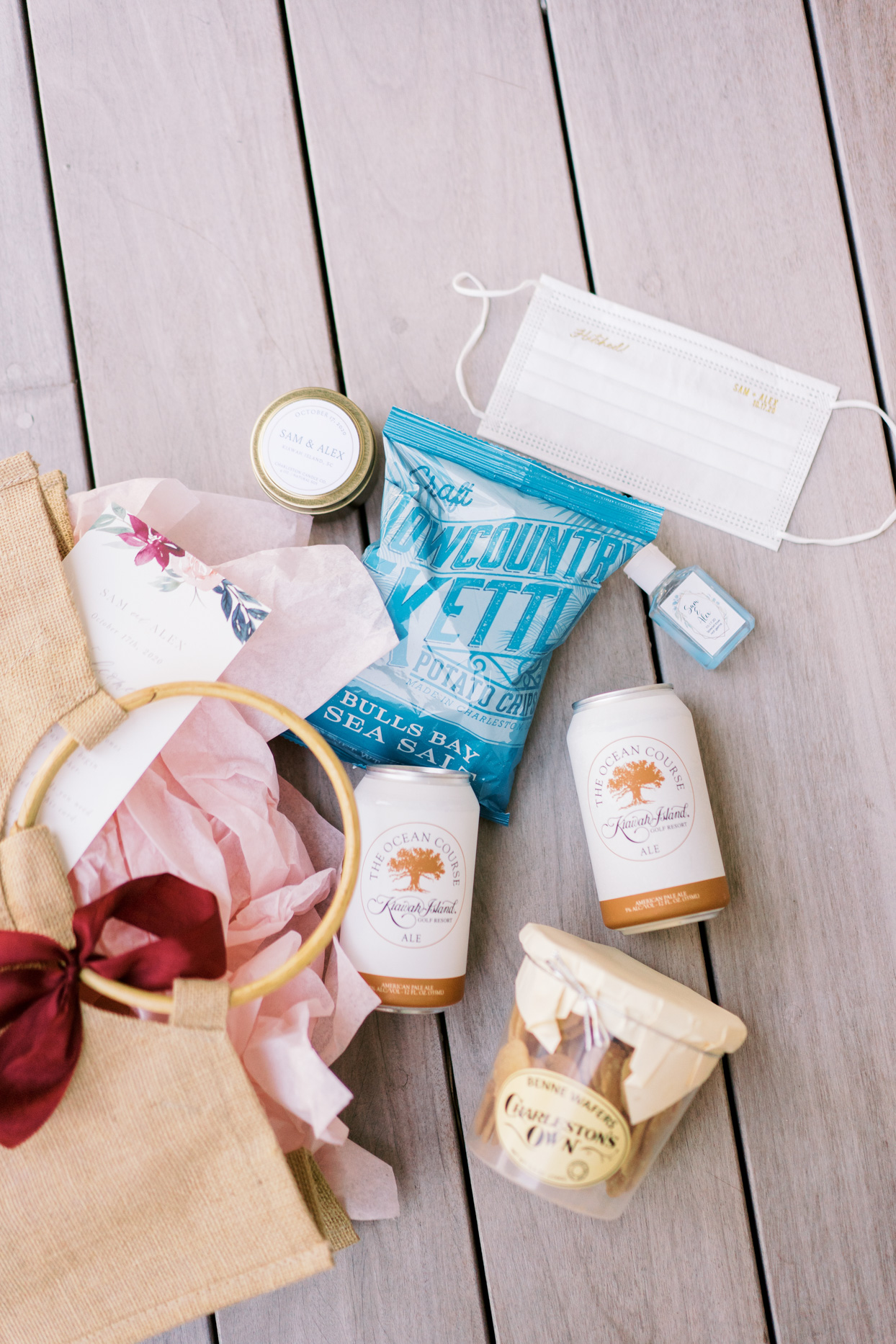 wedding welcome bags with wafers, ale, chips, mask, and candle