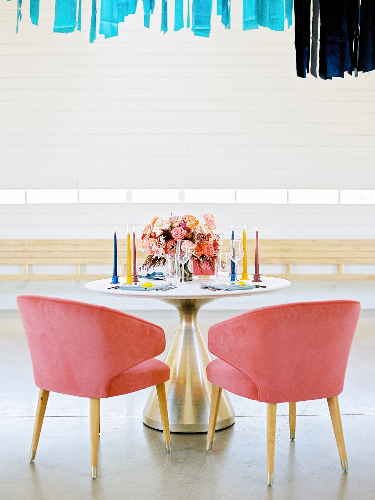 round wedding sweetheart table with velvet coral chairs