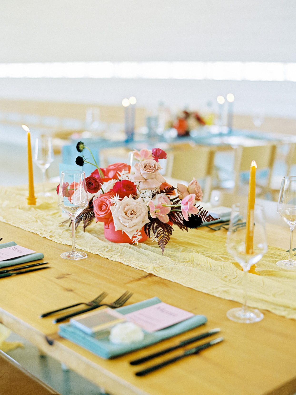 yellow runner and pink florals on reception table