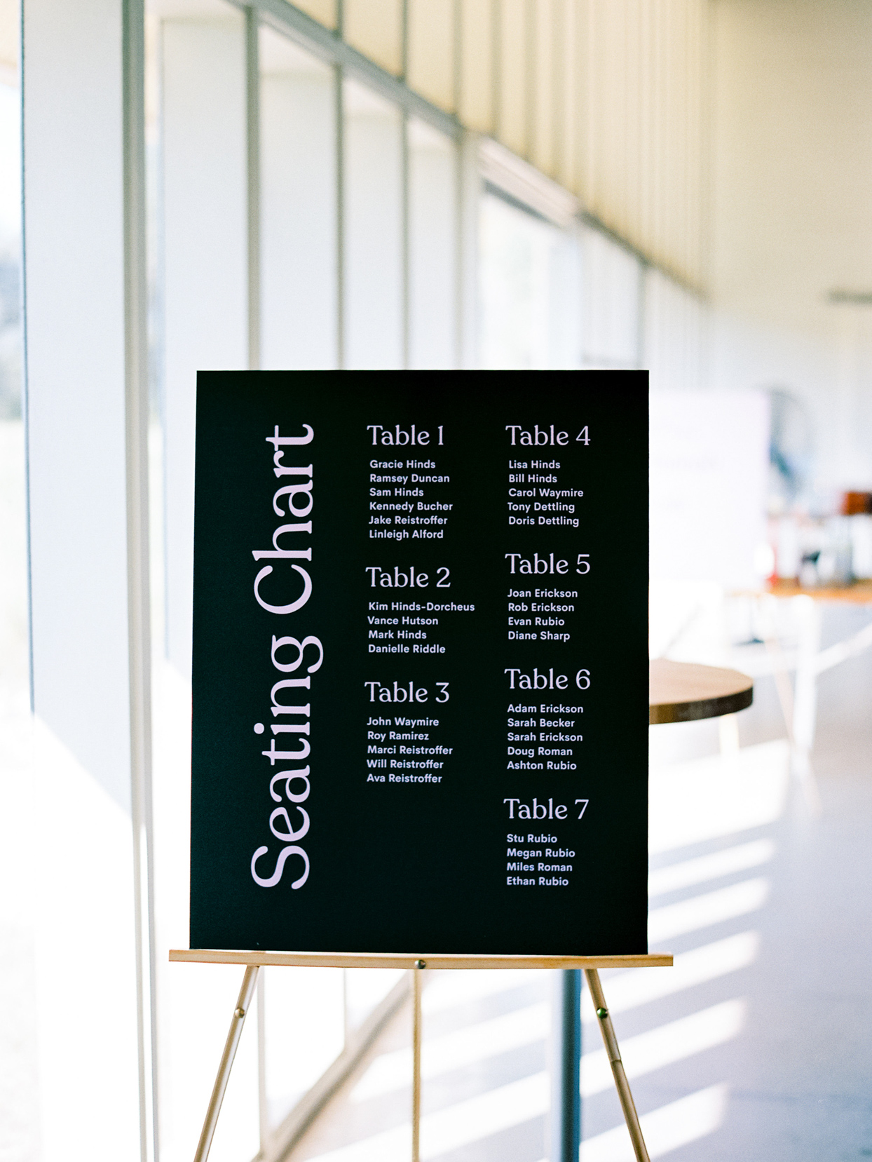 black and white seating chart board on easel