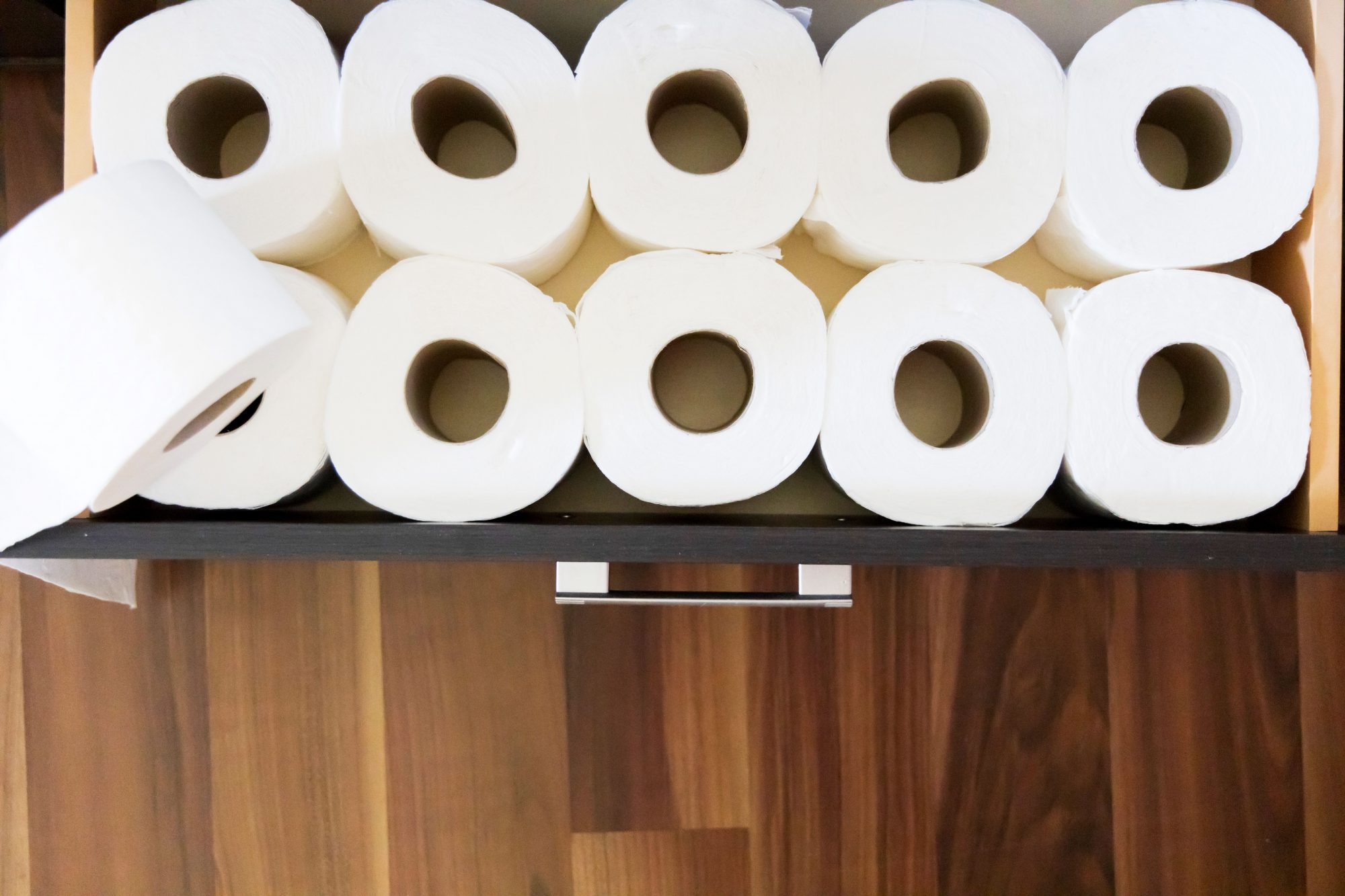 organized toilet paper in drawer