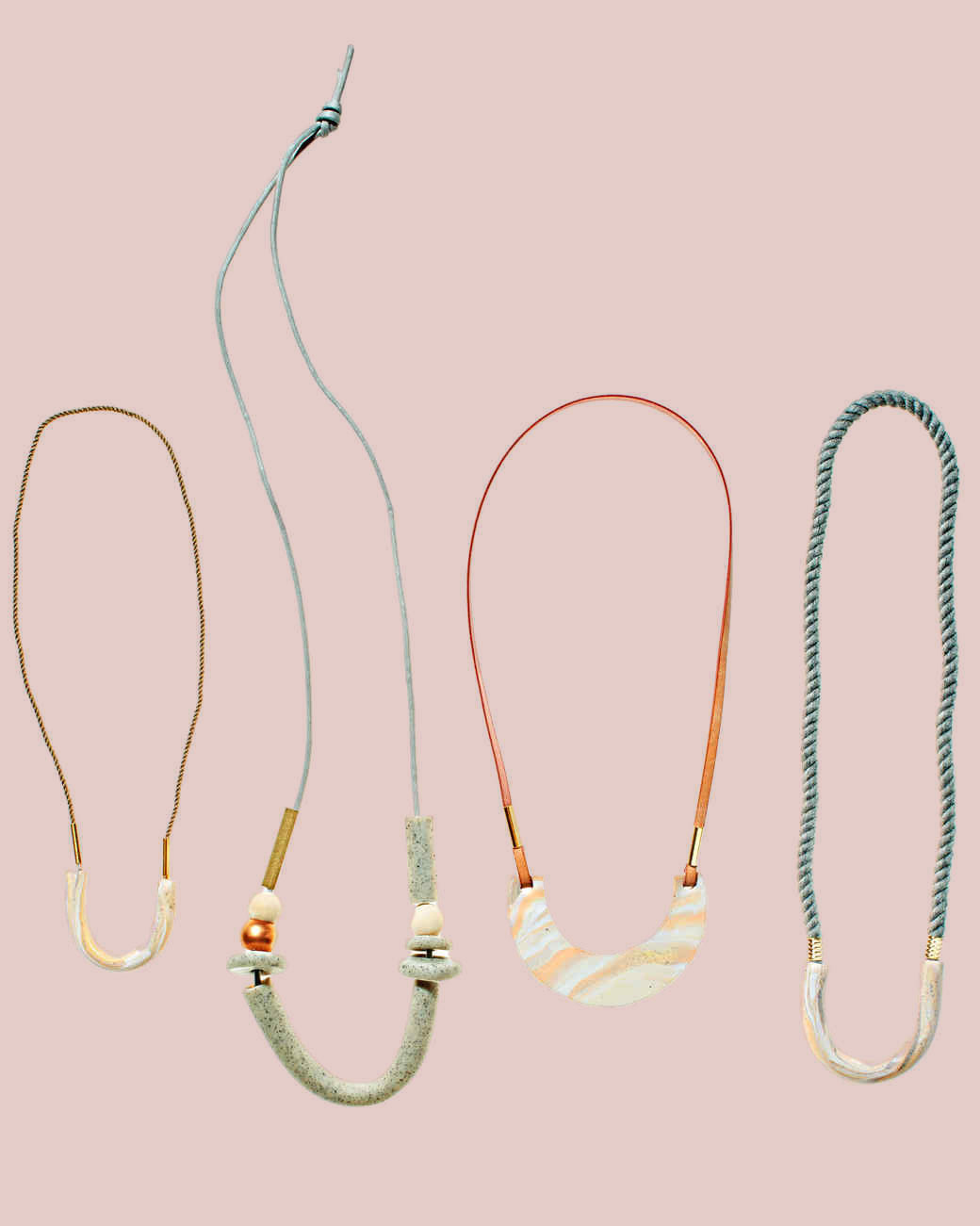assorted clay tube and crescent shaped pendants