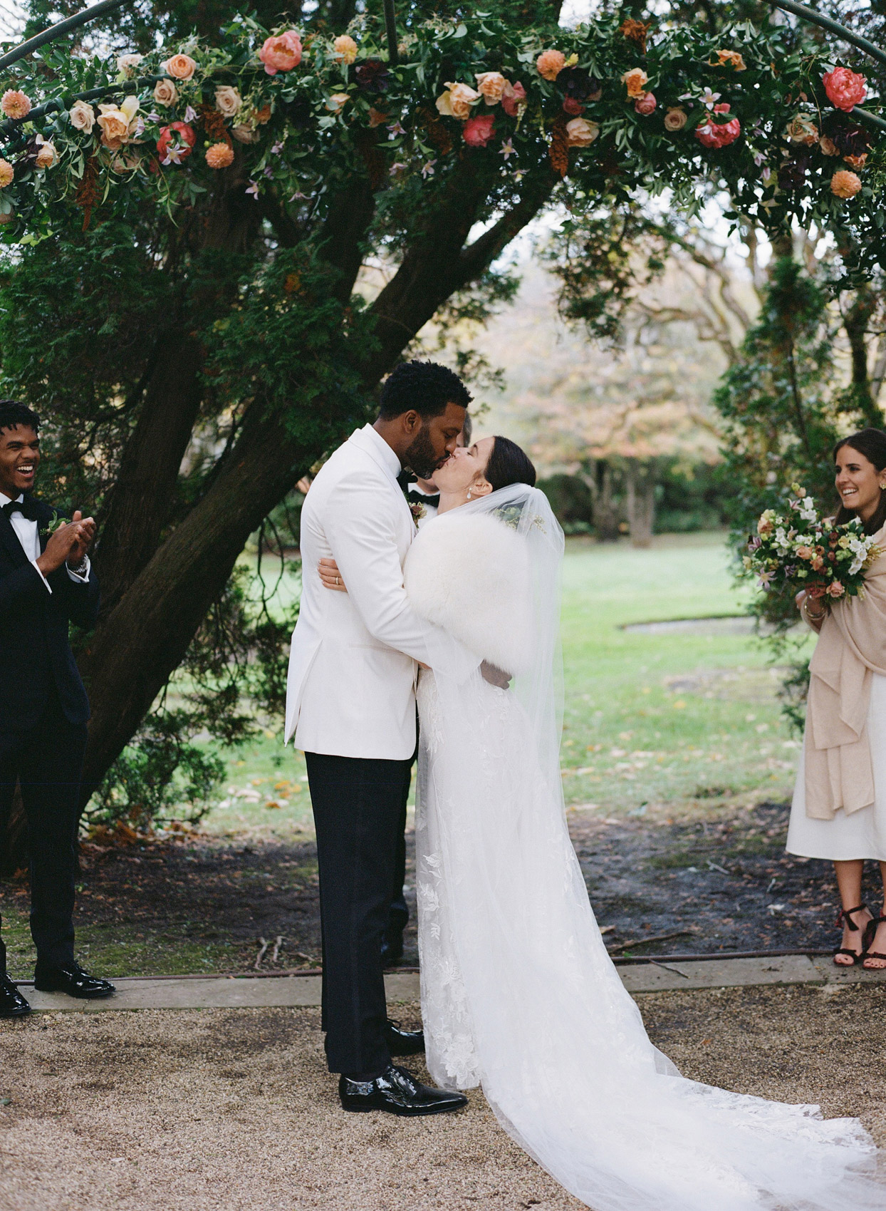 bride and groom ceremony kiss