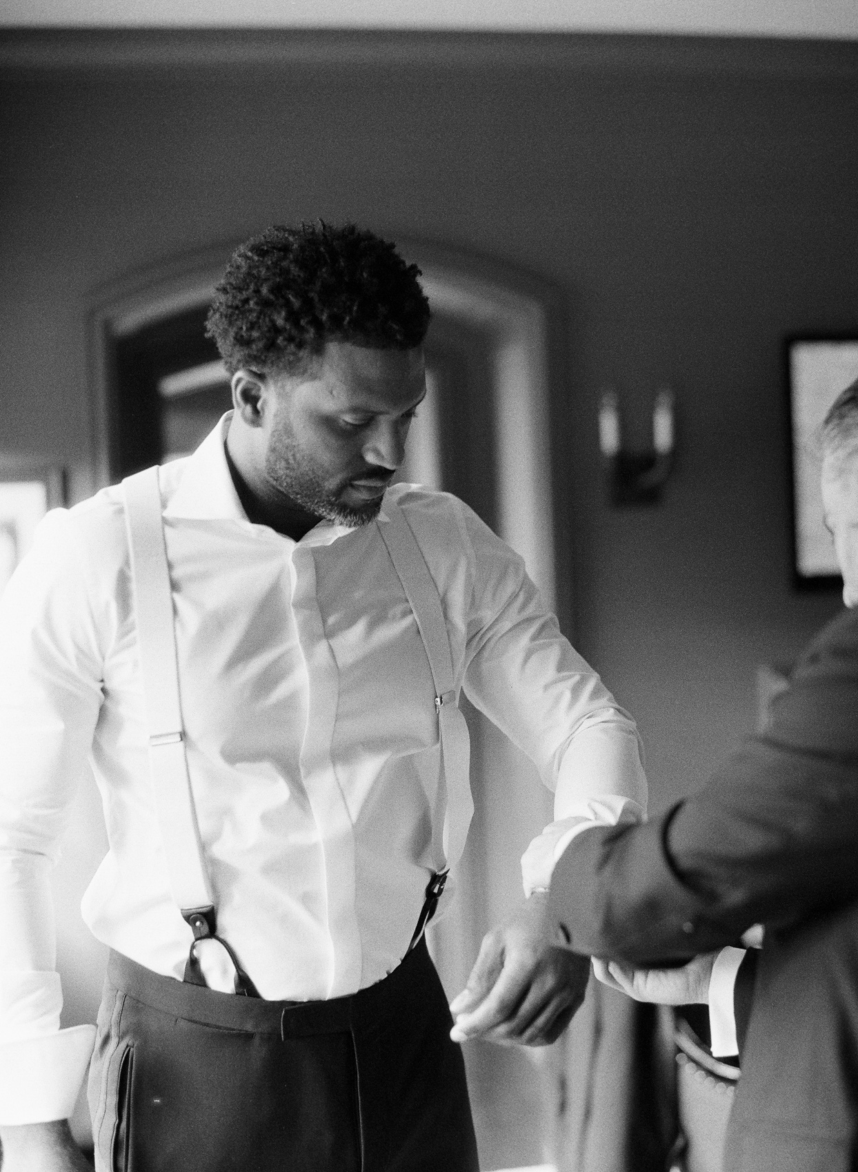 groom getting ready for ceremony