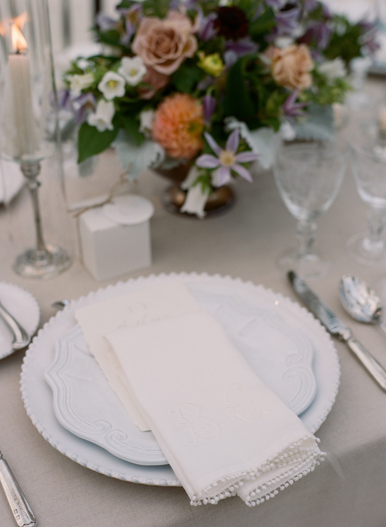 place setting with plates and napkins