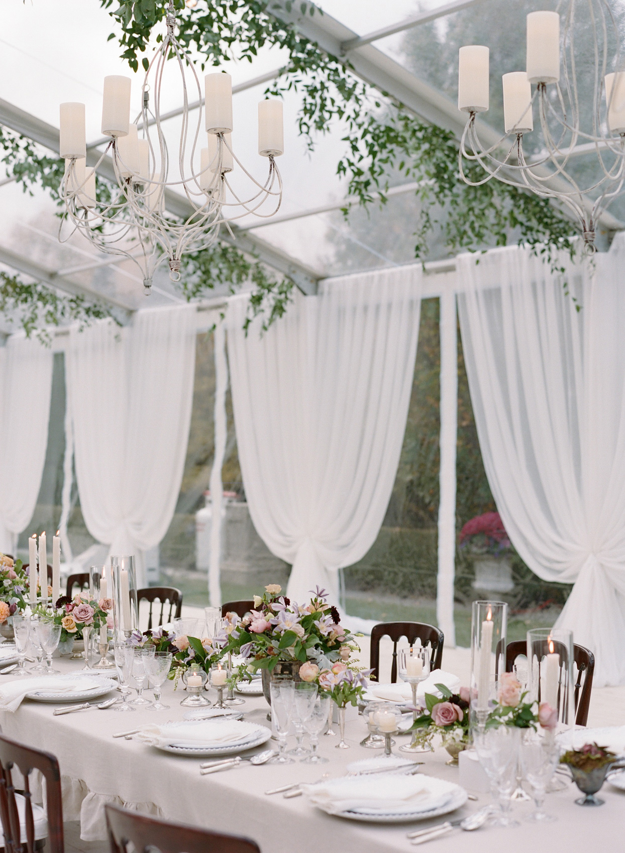 reception head table with florals
