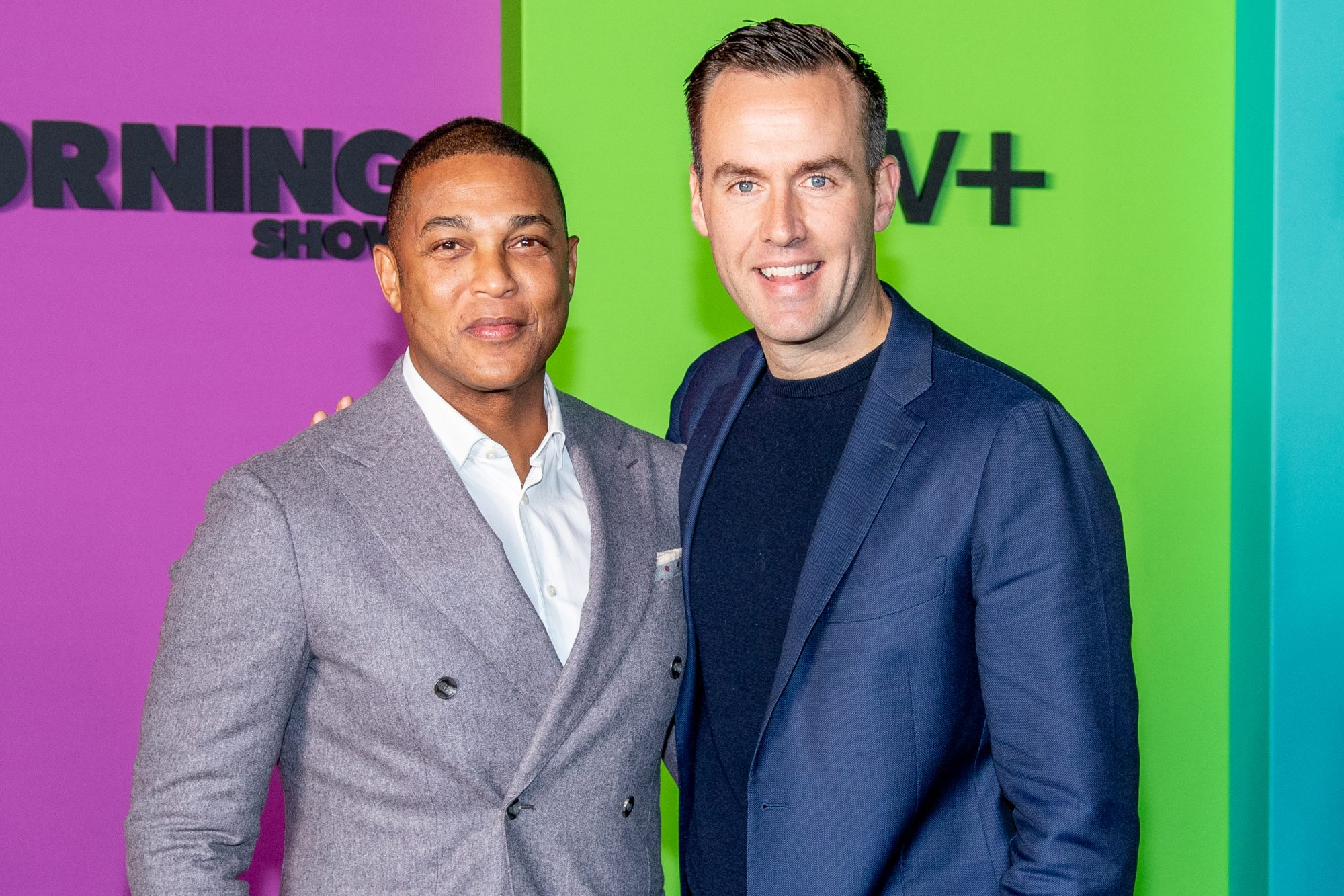 don lemon and tim malone posing and smiling on the red carpet