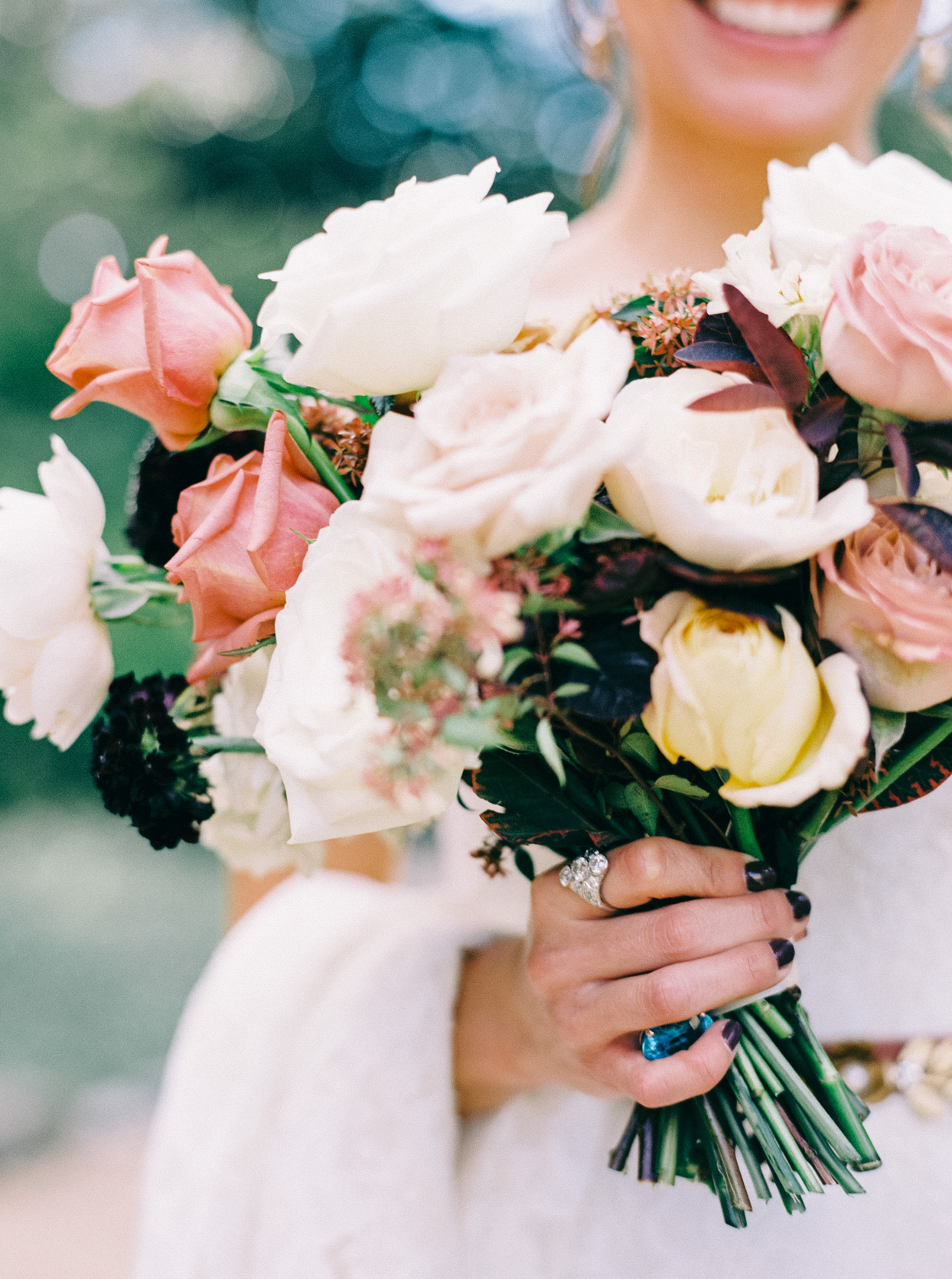 bride holding white and pink floral bouquet