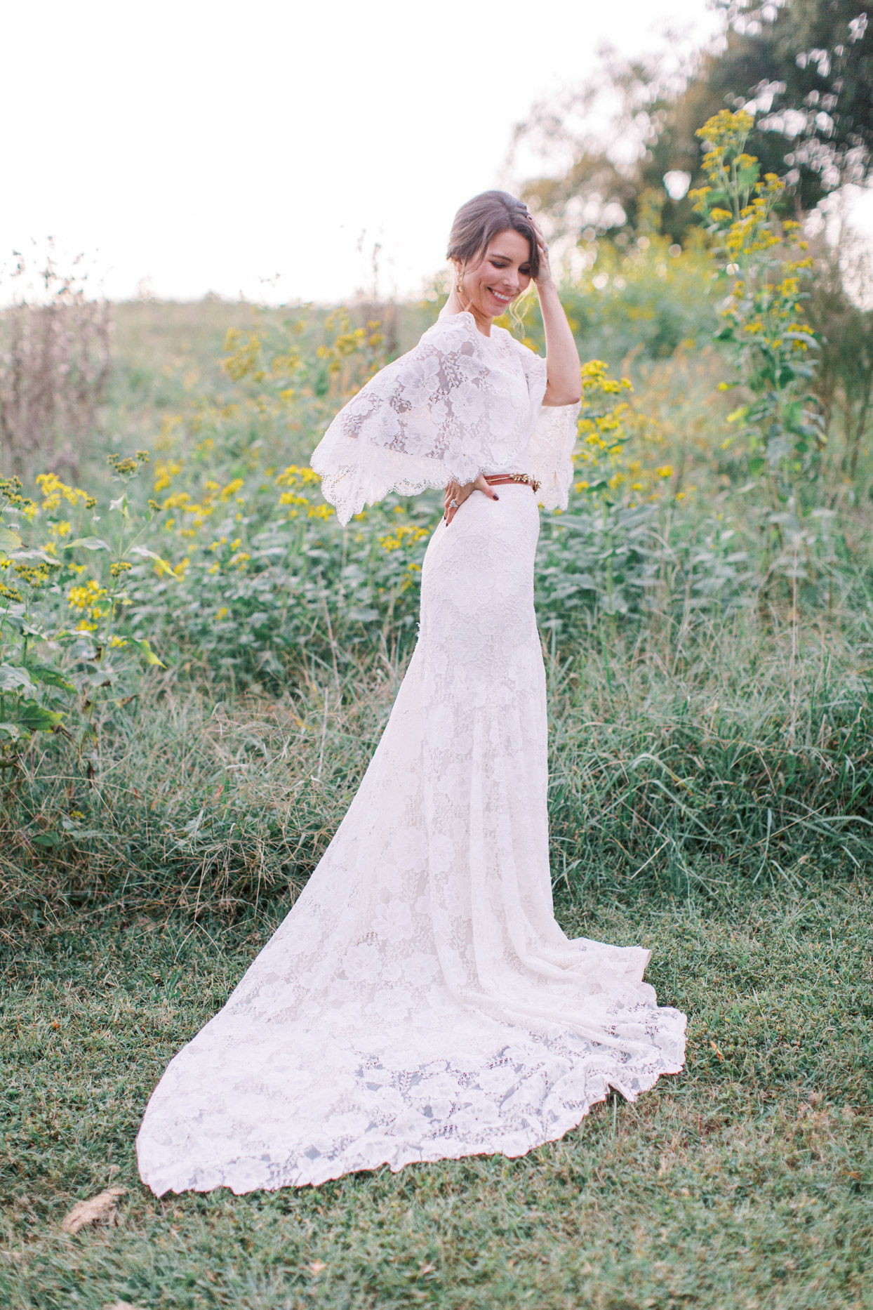 bride in flowing lace wedding dress with cape