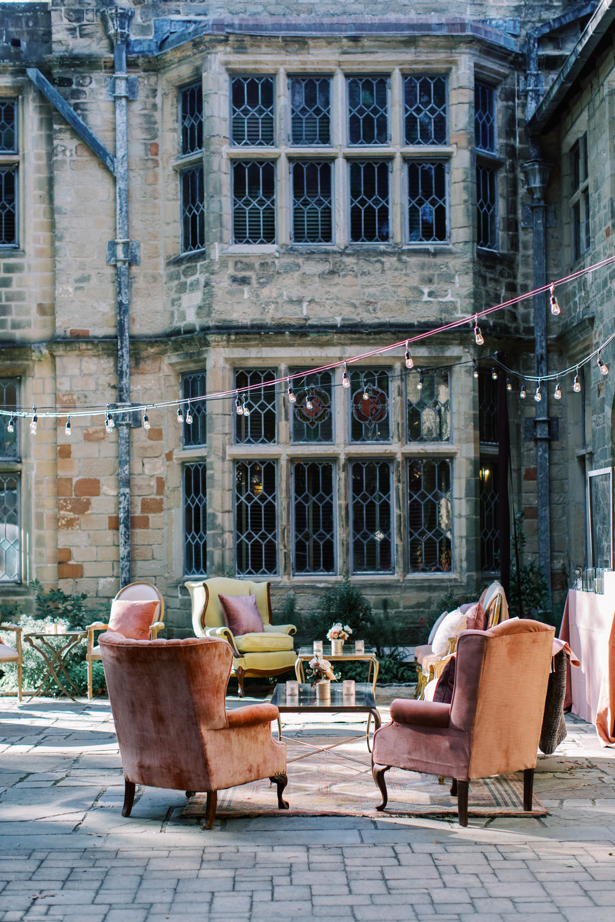 elegant lounge chairs set up for wedding cocktail hour in courtyard