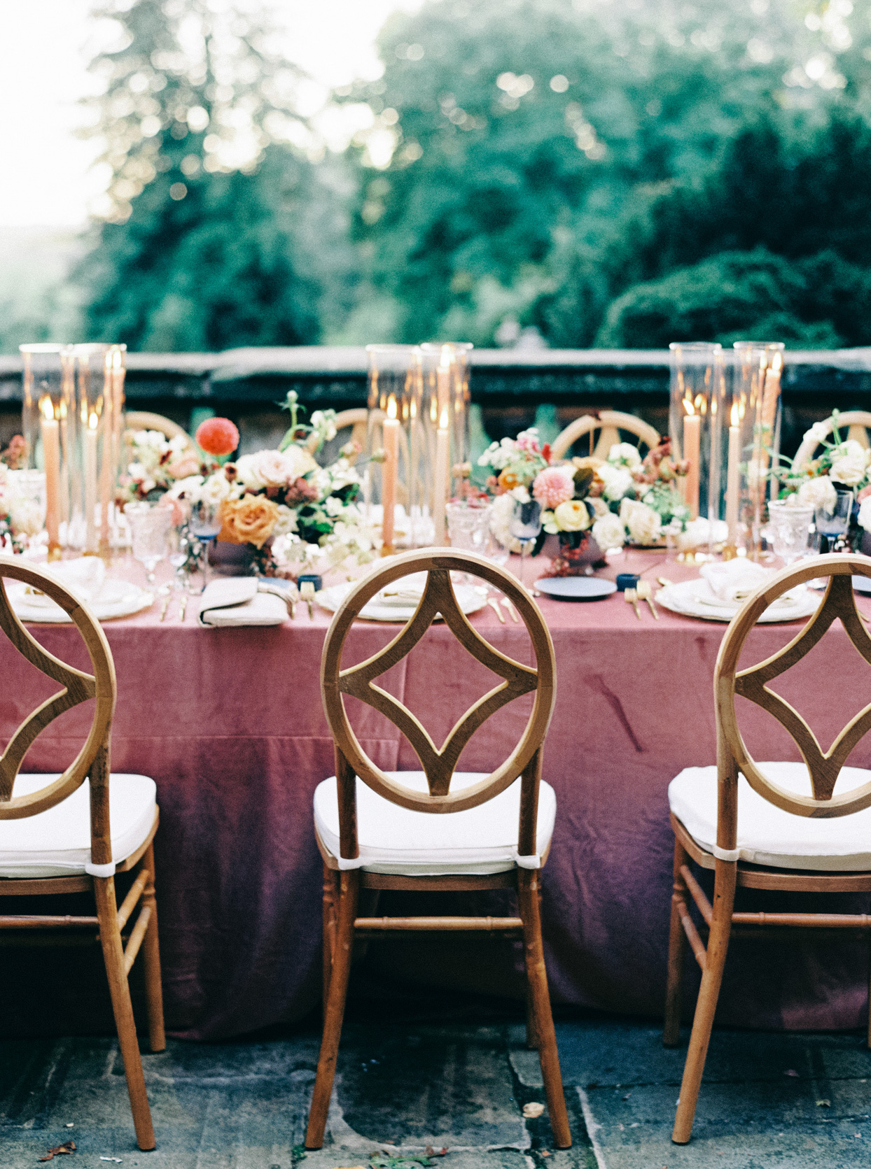 wedding reception table with wooden chairs on balcony
