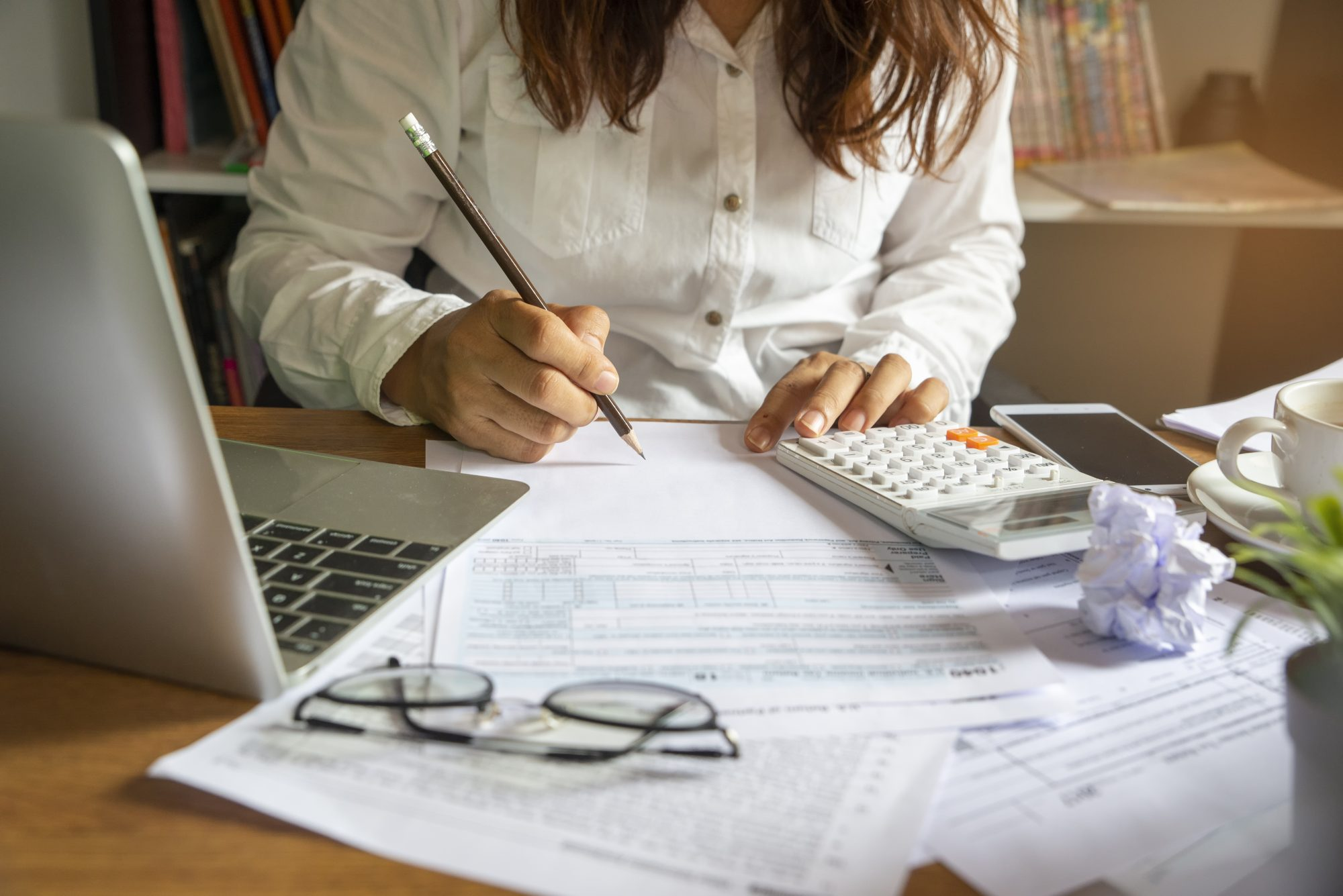 filling out tax from on desk