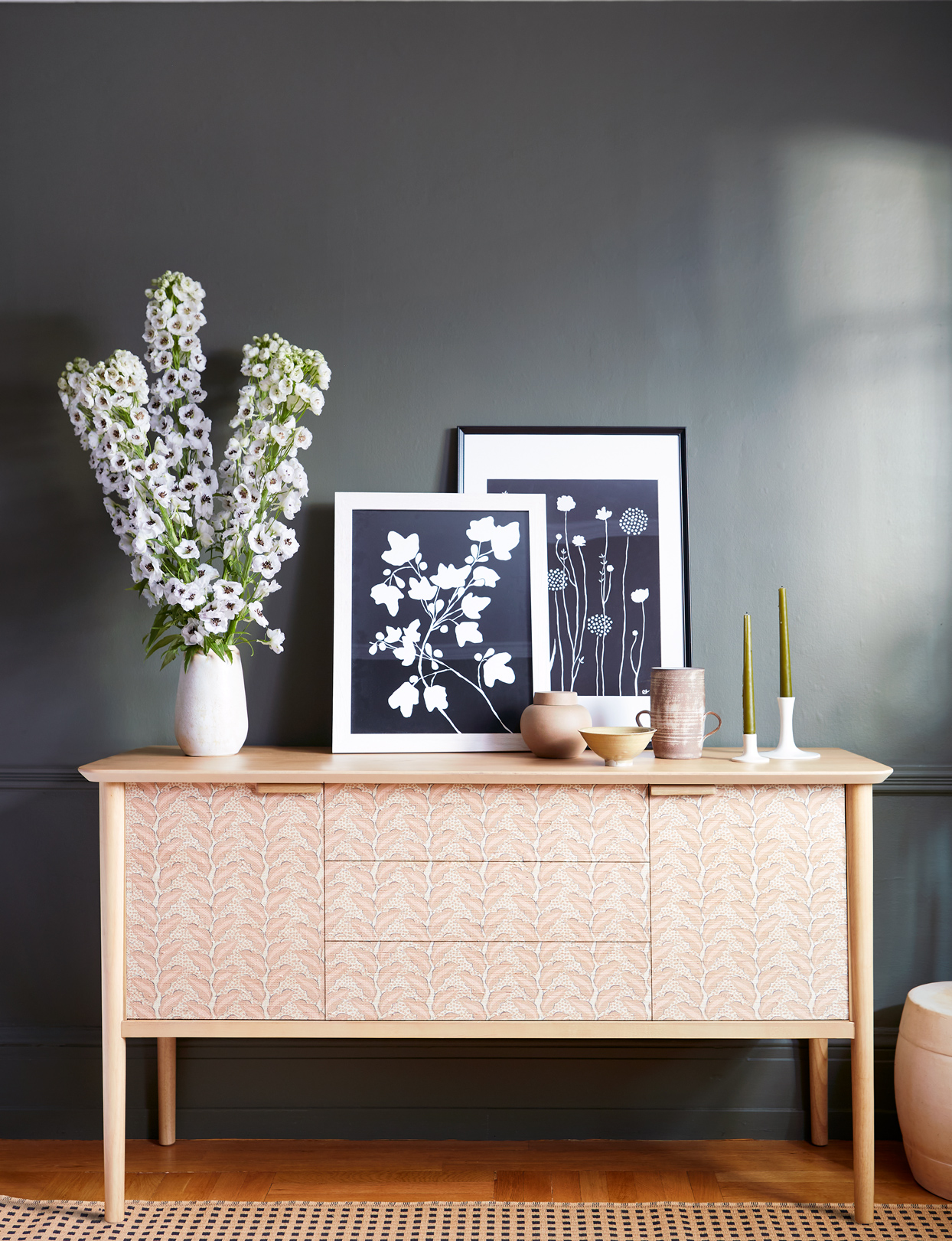 botanical cyanotype prints displayed on floral dresser