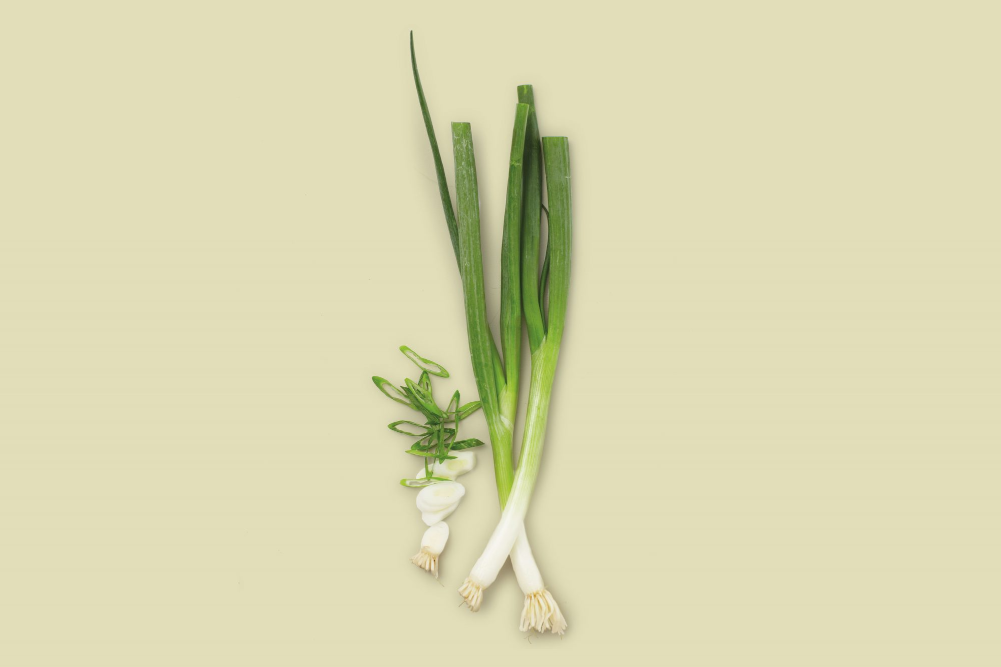 scallions on beige background