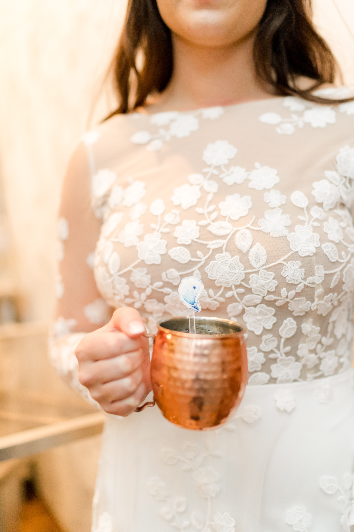 bride holding mule cup wedding cocktail