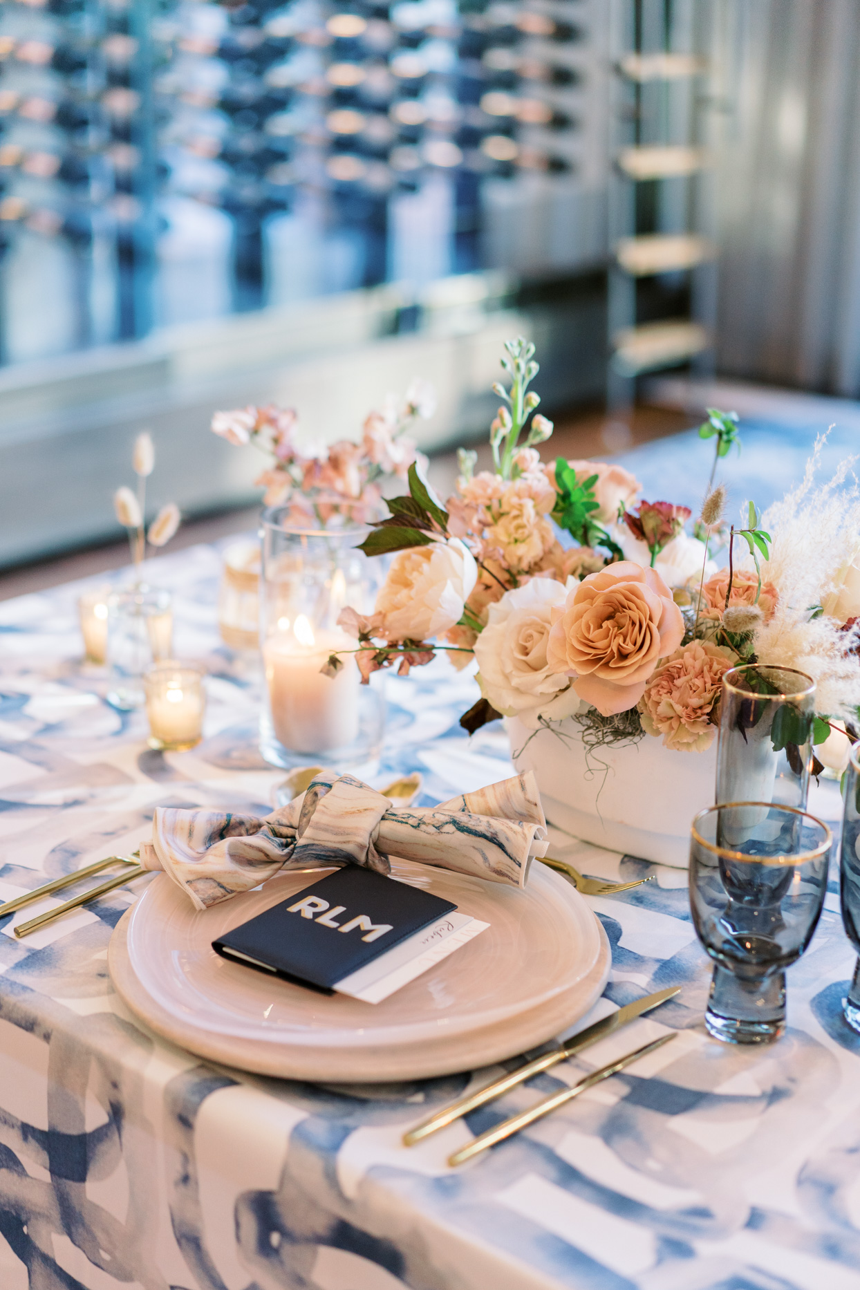 blush and blue toned wedding reception table settings