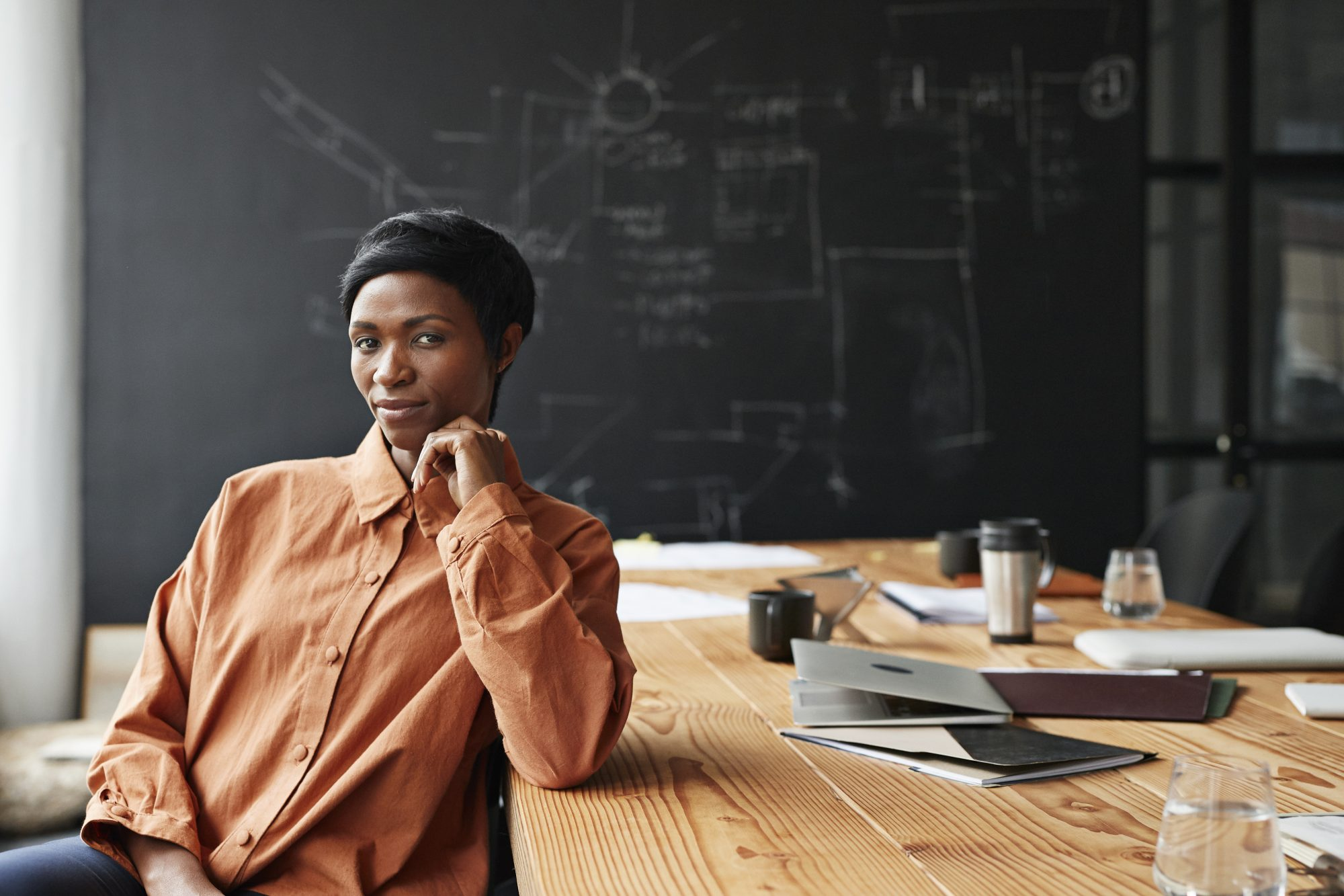 entrepreneur woman sitting at board room table