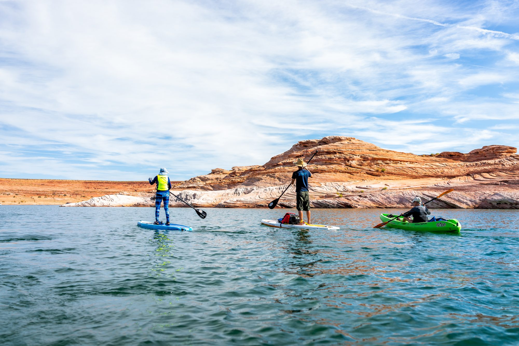 group paddle boarding on lake powell