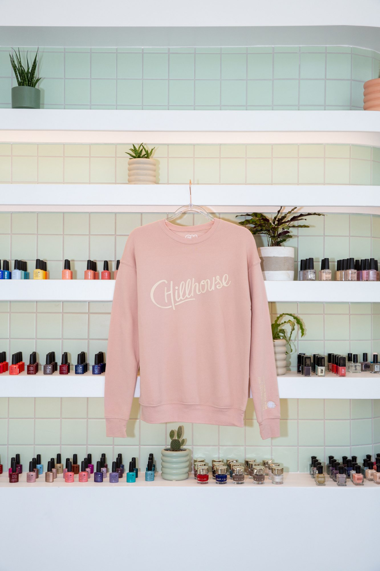 sweater hanging in chillhouse soho flagship location