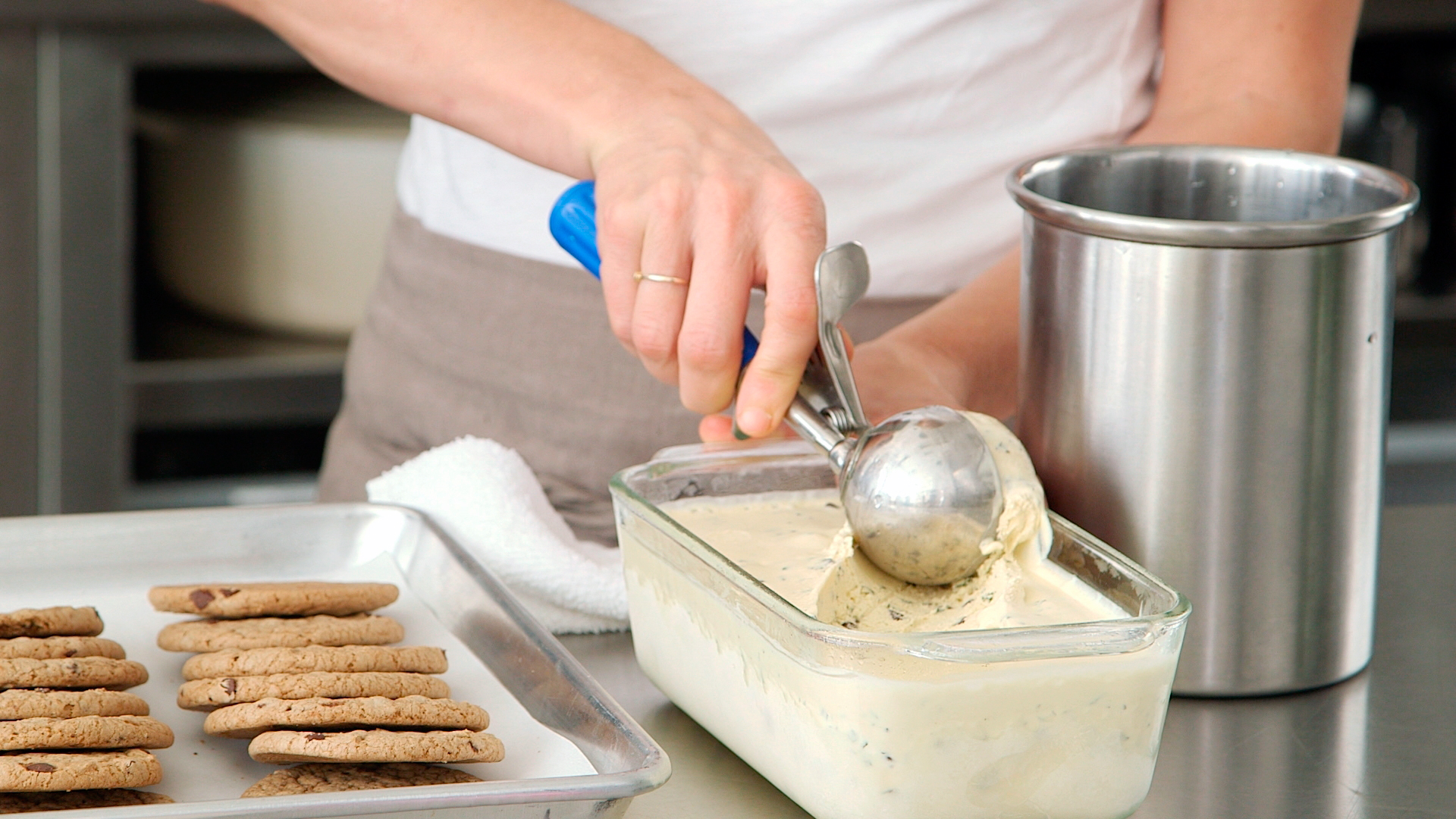 scooping homemade ice-cream from dish