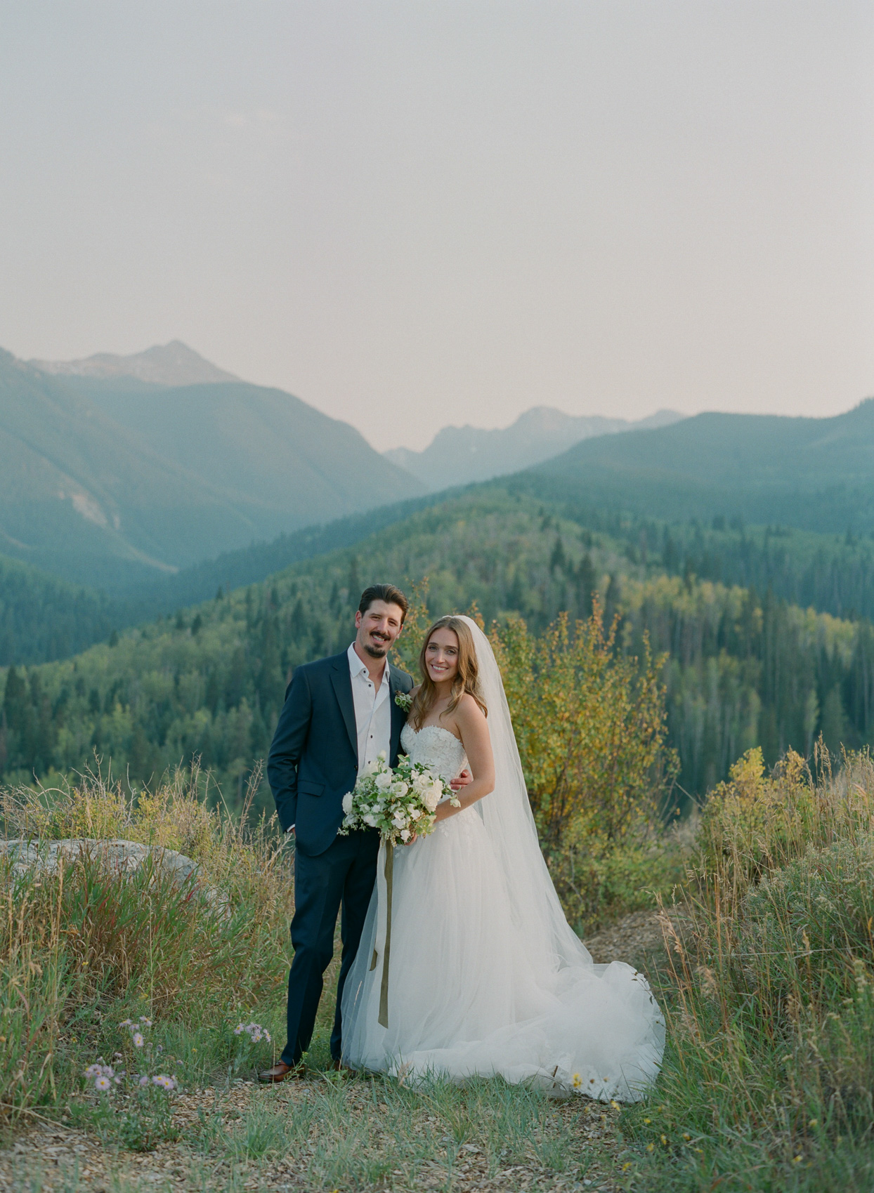 bride and groom on trail