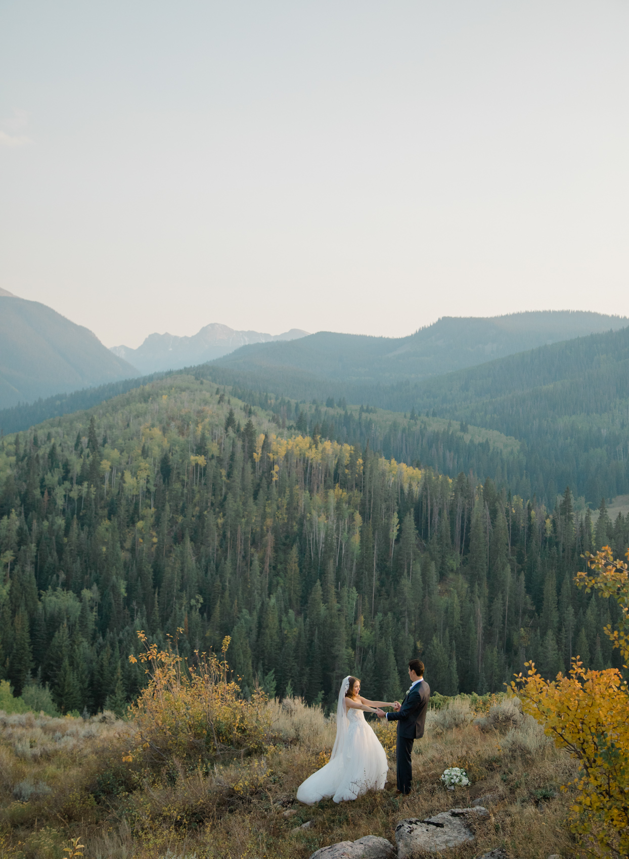 mountain landscape with bride and groom
