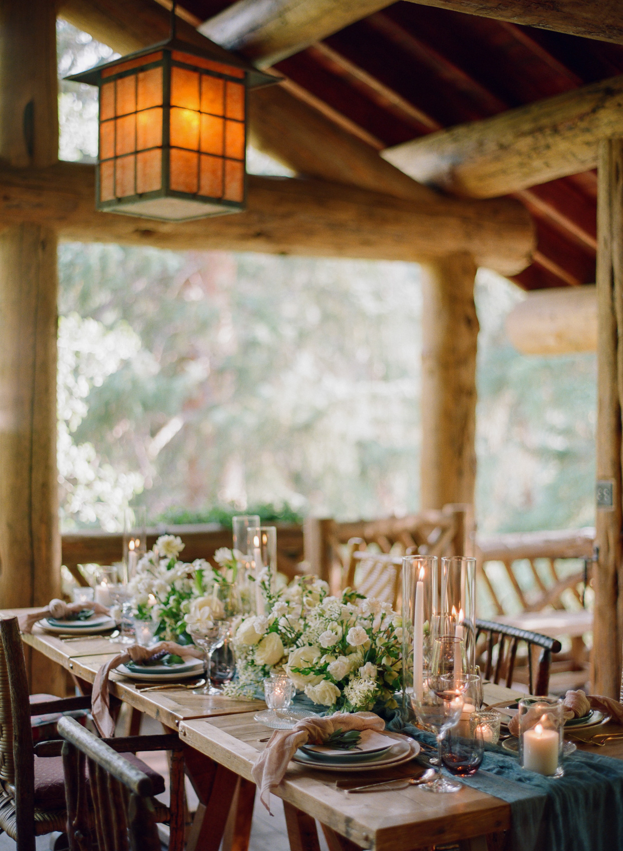 reception tables set with flowers and candles