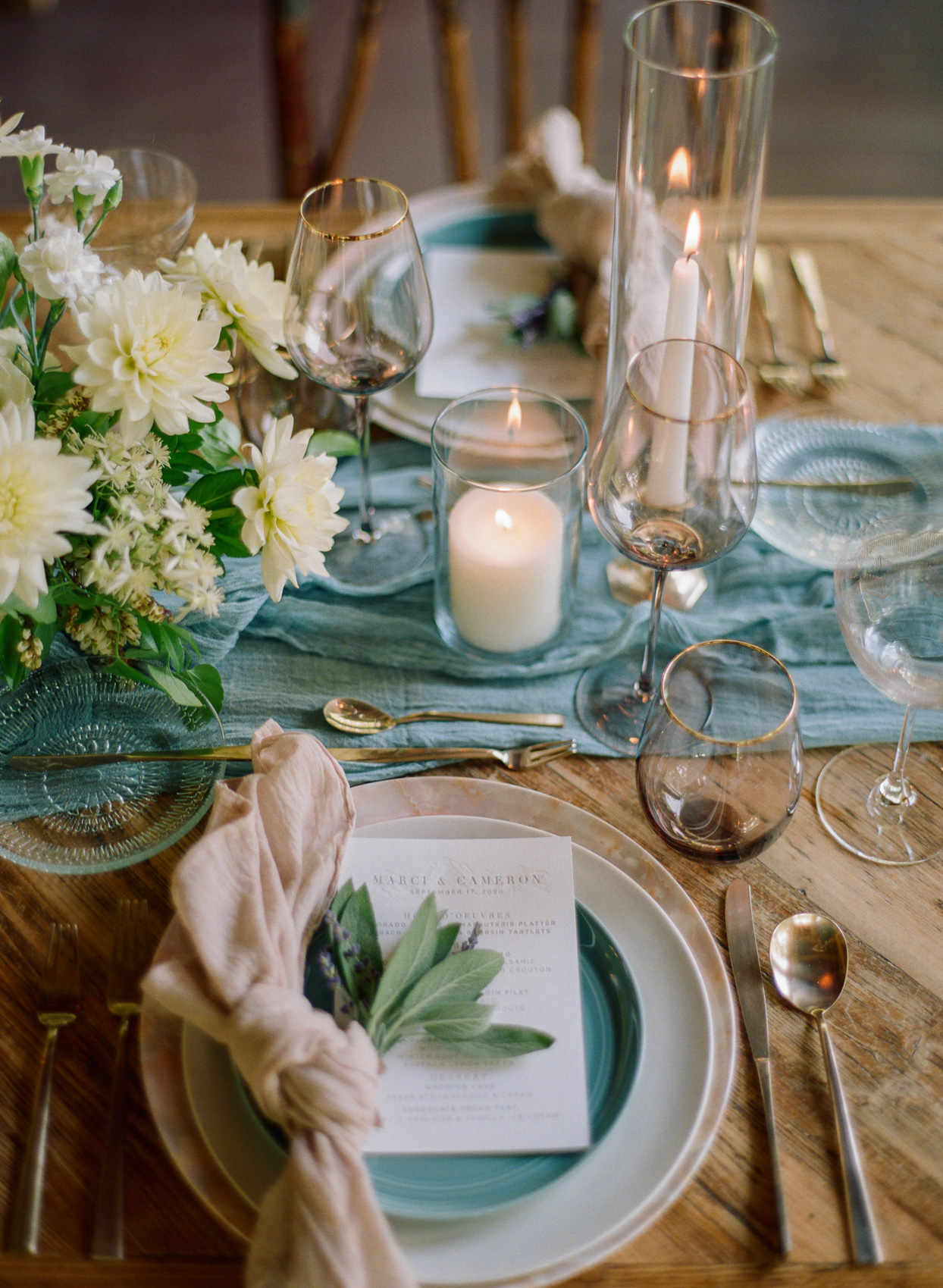table setting with menu and floral arrangement