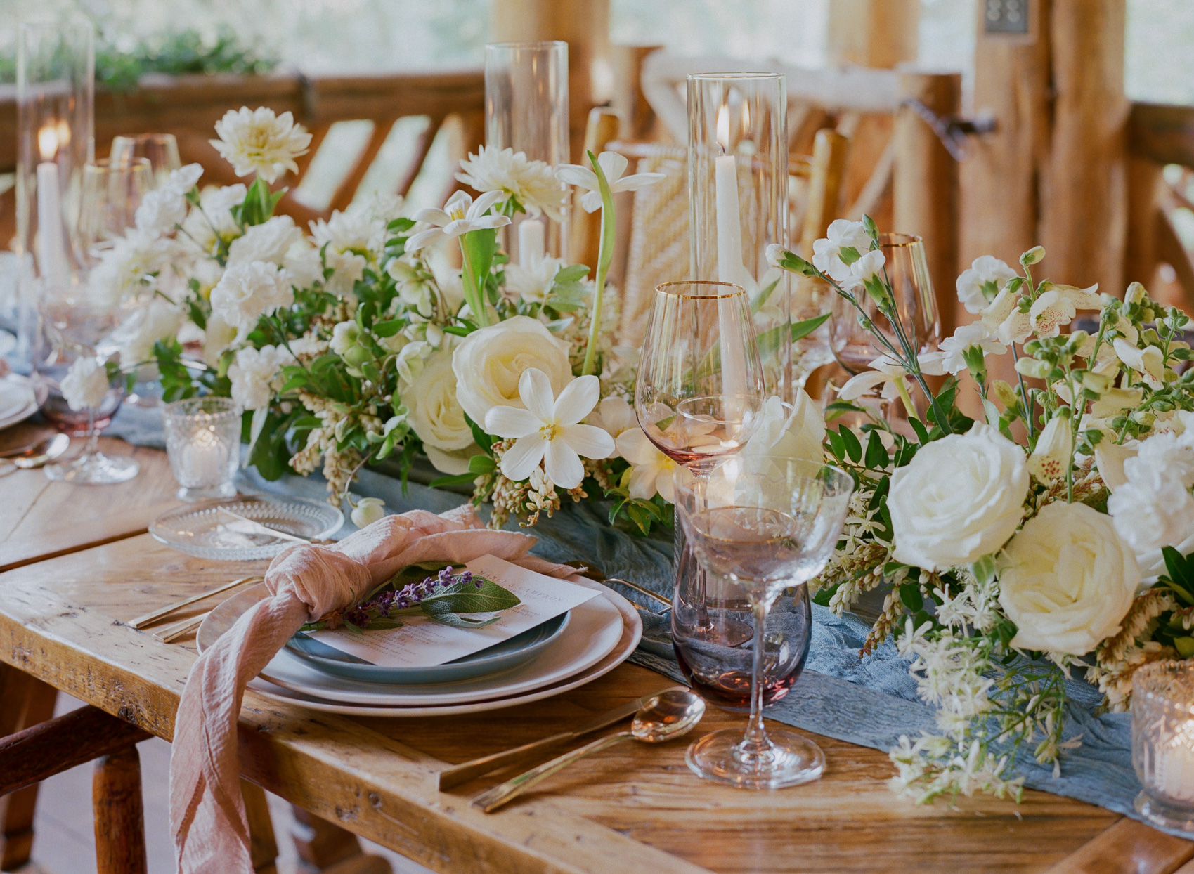 table setting up close with floral details and blue table runner