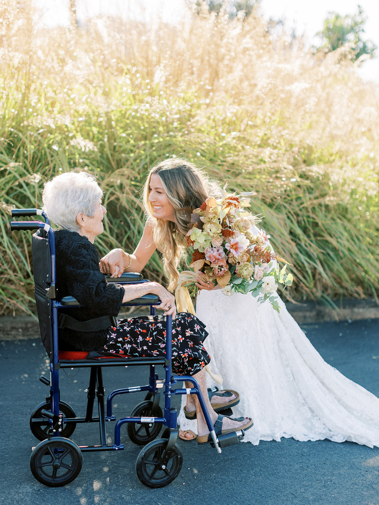 bride greeting grandmother in wheelchair